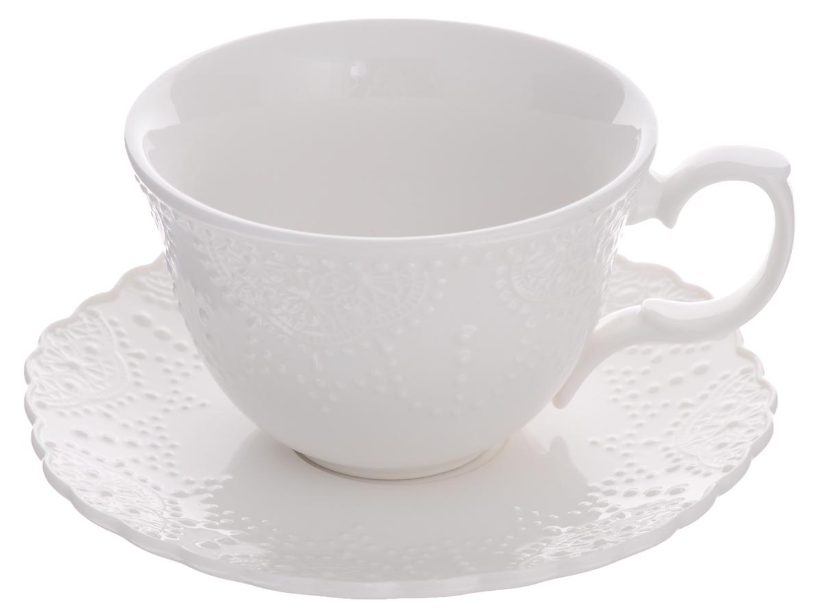Чайная пара Walmer Vivien, цвет: белый, 2 предметаW07270025Чайная пара Walmer Vivien состоит из чашки и блюдца, изготовленных из высококачественного фарфора и оформленных рельефным рисунком. Яркий дизайн, несомненно, придется вам по вкусу. Чайная пара Walmer Vivien украсит ваш кухонный стол, а также станет замечательным подарком к любому празднику. Объем чашки: 250 мл. Диаметр чашки (по верхнему краю): 10 см. Высота чашки: 7 см. Диаметр блюдца: 15 см.