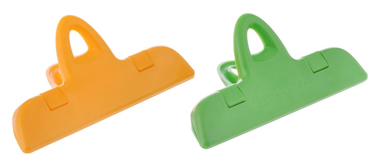 Клипсы для пакетов Tescoma Presto, цвет: оранжевый, зеленый, длина 11 см, 2 шт420764_желтый, зеленыйКлипсы для пакетов Tescoma Presto, изготовленные из прочной пластмассы, предназначены для герметичного хранения продуктов в пакетах. Например, для хранения специй, кофе, замороженных овощей в холодильнике и т.д. Продукты более длительное время сохраняются свежими. Можно мыть в посудомоечной машине. Размер клипсы: 11 х 6 х 4 см. Длина клипсы: 11 см.