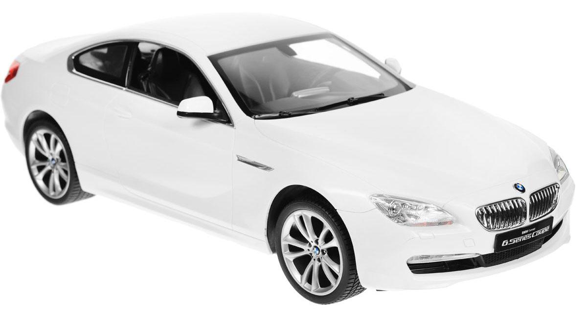 Rastar Радиоуправляемая модель BMW 6S цвет белый52300Радиоуправляемая модель Rastar BMW 6S со световыми эффектами, являющаяся точной копией настоящего автомобиля, - отличный подарок не только ребенку, но и взрослому. Автомобиль изготовлен из современных прочных материалов и обладает высокой стабильностью движения, что позволяет полностью контролировать его процесс, управляя без суеты и страха сломать игрушку. Основные направления движения автомобиля: вперед-назад-влево-вправо. Движение вперед и назад сопровождается сигнальными световыми эффектами фар. Прорезиненные колеса обеспечивают превосходное сцепление с любой поверхностью пола. Автомобиль работает от аккумулятора Ni-Cd AA 600 mAh 9.6V, заряжающегося от электрической сети. В комплект входят автомобиль, пульт управления, аккумулятор, зарядное устройство и инструкция на русском языке. Автомобиль работает от аккумулятора Ni-Cd AA 600 mAh 9.6V (входит в комплект), пульт управления - от 1 батарейки 9V 6F22 (не входит в комплект).