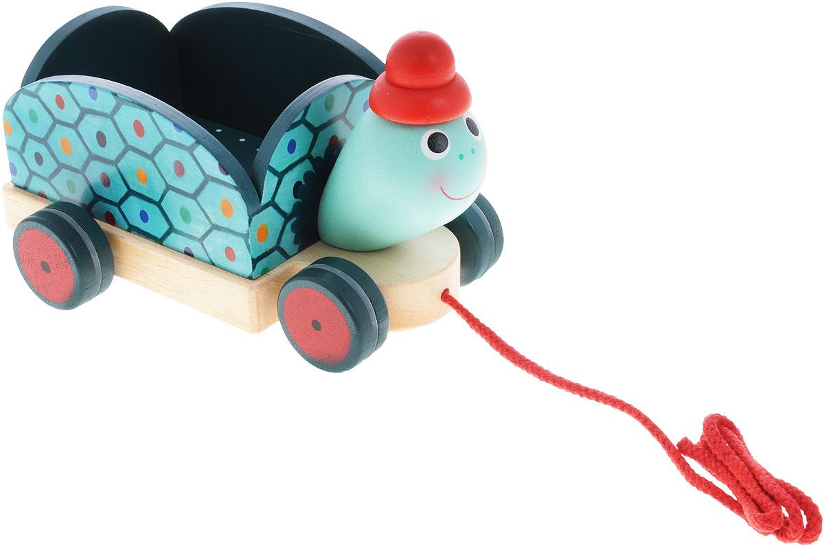 Djeco Игрушка-каталка Черепашка Клементин06250Деревянная игрушка-каталка Djeco Черепашка Клементин непременно понравится вашему малышу и подойдет для игры как дома, так и на свежем воздухе. Она выполнена из дерева с использованием нетоксичных красок в виде забавной черепашки Клементин. Края игрушки закруглены, чтобы избежать травмирования. Спина черепашки имеет бортики, поэтому туда можно положить маленькую игрушку и весело катать ее по комнате. Каталка оснащена четырьмя цветными колесиками с резиновыми вставками. За текстильную ленточку малыш сможет возить игрушку за собой. Игрушка-каталка Djeco Черепашка Клементин развивает пространственное мышление, цветовое восприятие, ловкость, равновесие и координацию движений.