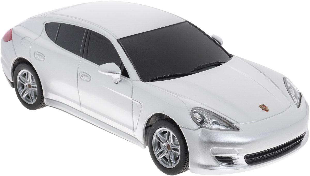 Rastar Радиоуправляемая модель Porsche Panamera цвет серебристый масштаб 1:2446200_ серебристыйРадиоуправляемая модель Rastar Porsche Panamera станет отличным подарком любому мальчику! Все дети хотят иметь в наборе своих игрушек ослепительные, невероятные и крутые автомобили на радиоуправлении. Тем более, если это автомобиль известной марки с проработкой всех деталей, удивляющий приятным качеством и видом. Одной из таких моделей является автомобиль на радиоуправлении Rastar Porsche Panamera. Это точная копия настоящего авто в масштабе 1:24. Возможные движения: вперед, назад, вправо, влево, остановка. Имеются световые эффекты. Пульт управления работает на частоте 27 MHz. Для работы игрушки необходимы 3 батарейки типа АА (не входят в комплект). Для работы пульта управления необходимы 2 батарейки типа АА (не входят в комплект).