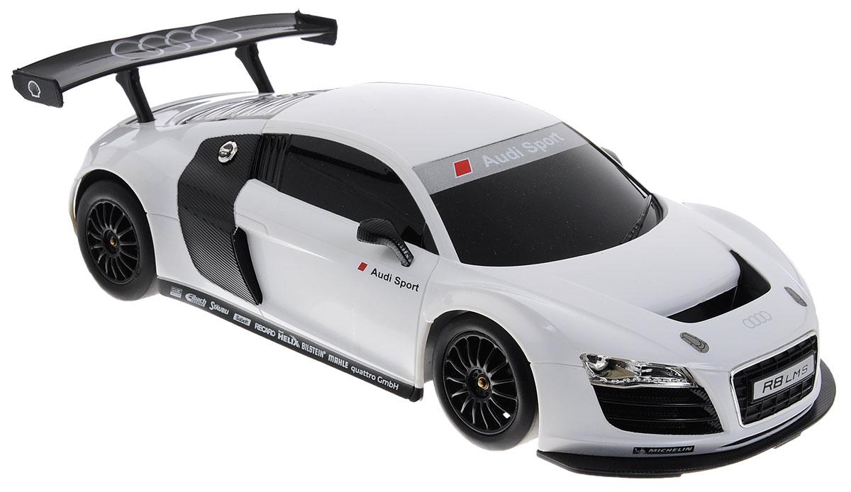 Rastar Радиоуправляемая модель Audi R8 цвет белый масштаб 1:1853600-10Радиоуправляемая модель Rastar Audi R8 станет не только игрушкой, но и частью коллекции, которую может собирать и ребенок и взрослый. Гоночное авто имеет реалистичный вид, спортивный характер, высокую маневренность и динамичность. Поэтому играть с такой машиной можно не только в доме, но и даже на улице. Управление авто осуществляется благодаря пульту-рулю, с помощью которого авто может поворачивать направо и налево, а также направляться вперед, назад и останавливаться. Пульт в виде руля выполнен в очень реалистичной форме и оснащен звуковыми эффектами. Машина работает от 4 батареек напряжением 1,5V типа АА (не входят в комплект). Пульт управления работает от 3 батареек напряжением 1,5V типа АА (не входят в комплект). Ваш ребенок часами будет играть с моделью, придумывая различные истории и устраивая соревнования. Порадуйте его таким замечательным подарком!
