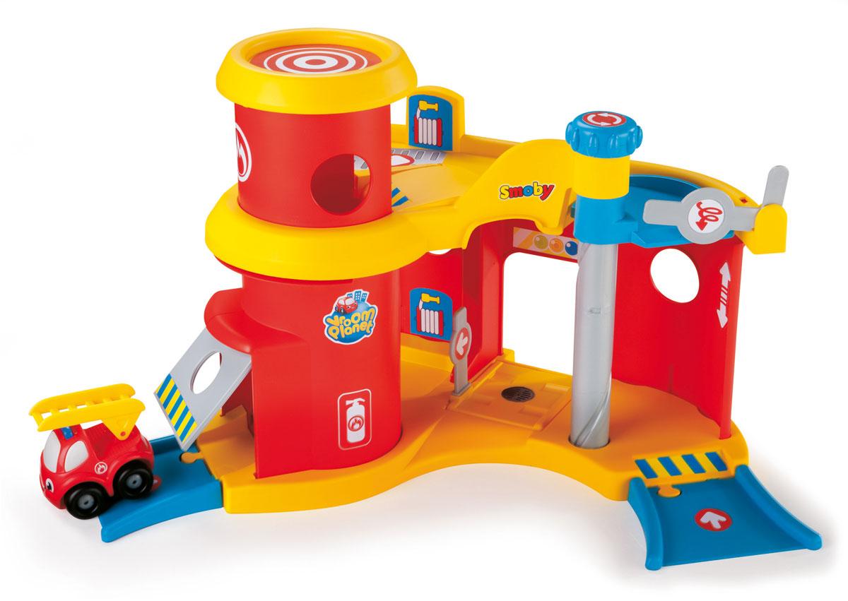 Smoby Игрушечный трек Пожарная станция Vroom Planet211293Пожарная станция Vroom Planet обязательно понравится вашему ребенку. Набор выполнен из качественного безопасного пластика ярких цветов. Двухэтажная пожарная станция включает в себя парковку, гараж, вертолетную площадку, лифт, спуски и красную пожарную машинку. Маленькие фантазеры с удовольствием будут представлять себя в роли пожарного, отправляя машинки на вызов, пользуясь лифтом и гаражом с поднимающейся дверью. В игрушке отсутствуют острые углы, а машинка имеет очаровательные глазки и улыбку. Ваш ребенок с удовольствием будет играть с набором, придумывая захватывающие истории.