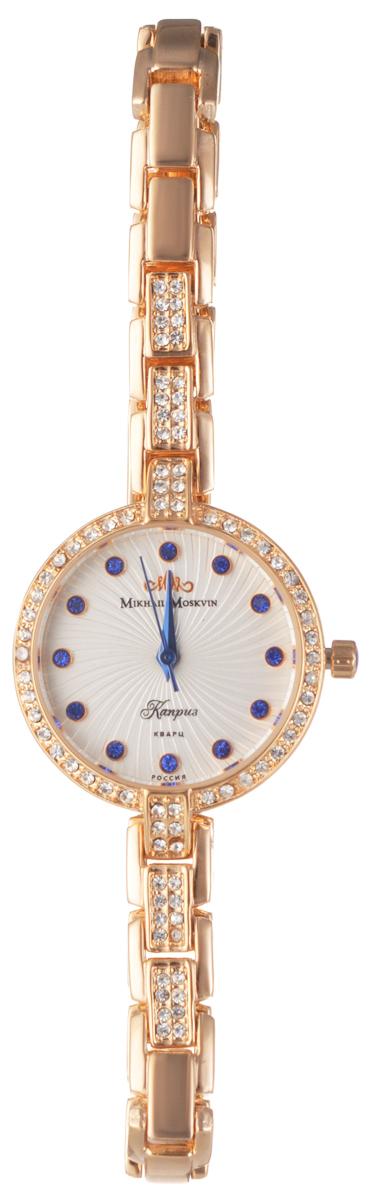 Часы женские наручные Mikhail Moskvin Каприз, цвет: золотой, белый, синий. 577-8-2577-8-2Элегантные женские часы Mikhail Moskvin Каприз изготовлены из нержавеющей стали и минерального стекла. Изделие оформлено стразами и символикой бренда. Корпус часов оснащен кварцевым механизмом, который имеет степень влагозащиты равную 3 Bar, а также устойчивым к царапинам минеральным стеклом. Практичный складной замок, предусмотренный в конструкции браслета, позволит с легкостью снимать и надевать изделие. Часы поставляются в фирменной упаковке. Часы Mikhail Moskvin Каприз подчеркнут изящность женской руки и отменное чувство стиля у их обладательницы.