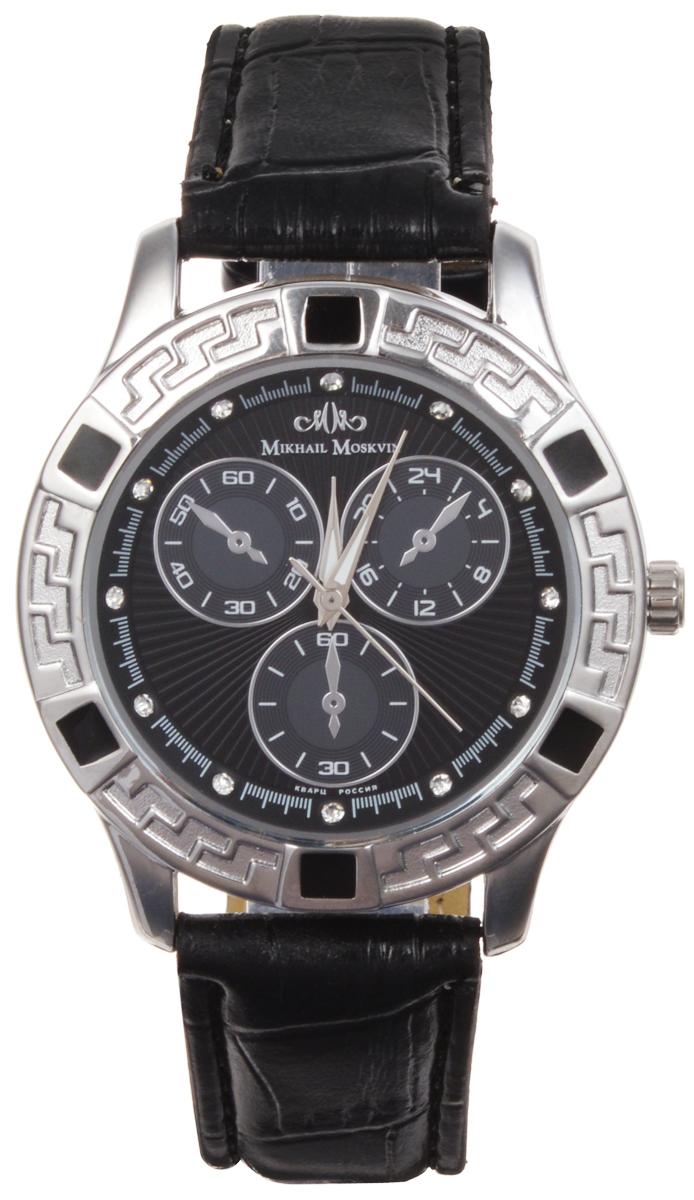 Часы женские наручные Mikhail Moskvin Каприз, цвет: черный, серебряный. 608-1-2608-1-2Элегантные женские часы Mikhail Moskvin Каприз изготовлены из нержавеющей стали, натуральной кожи и минерального стекла. Циферблат часов оформлен стразами и символикой бренда. Корпус часов оснащен кварцевым механизмом, который имеет степень влагозащиты равную 3 Bar, устойчивым к царапинам минеральным стеклом, три дополнительных циферблата с индикаторами суточного времени. Ремешок часов украшен декоративным тиснением под рептилию и оснащен классической пряжкой, которая позволит с легкостью снимать и надевать изделие. Часы поставляются в фирменной упаковке. Часы Mikhail Moskvin Каприз подчеркнут изящность женской руки и отменное чувство стиля у их обладательницы.