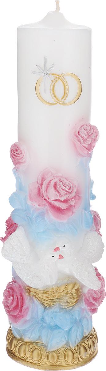 Свеча декоративная Принт Торг Очаг 2, цвет: голубой, розовый, высота 26 см69.028Свеча Принт Торг Очаг 2 предназначена для свадебной церемонии. Изделие выполнено из парафина, декорировано рельефом в виде двух колец, голубей и цветов и покрыто блестками. Зажигание домашнего очага молодой семьи - один из наиболее популярных брачных обычаев. Родители жениха и невесты зажигают свечи и поджигают ими свечу молодоженов, это олицетворяет передачу домашнего тепла и благосостояния от родителей к детям. Время горения - 48 часов. Диаметр свечи по верхнему краю: 5,2 см. Диаметр основания свечи: 7 см.