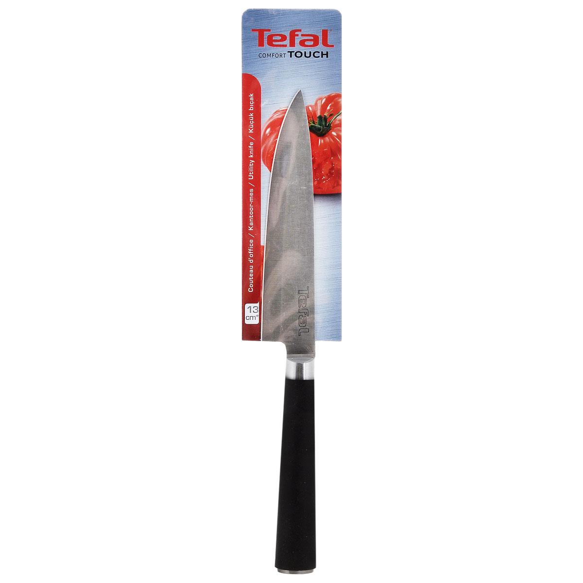 Нож многофункциональный Tefal Comfort Touch, длина лезвия 13 см2100071017Нож Tefal Comfort Touch выполнен из нержавеющей стали. Эргономичная ручка не выскользнет у вас из рук благодаря резиновому покрытию. Этот многофункциональный нож идеален для резки небольших овощей и фруктов, а также колбасы, сыра, масла. Общая длина ножа: 25,5 см.