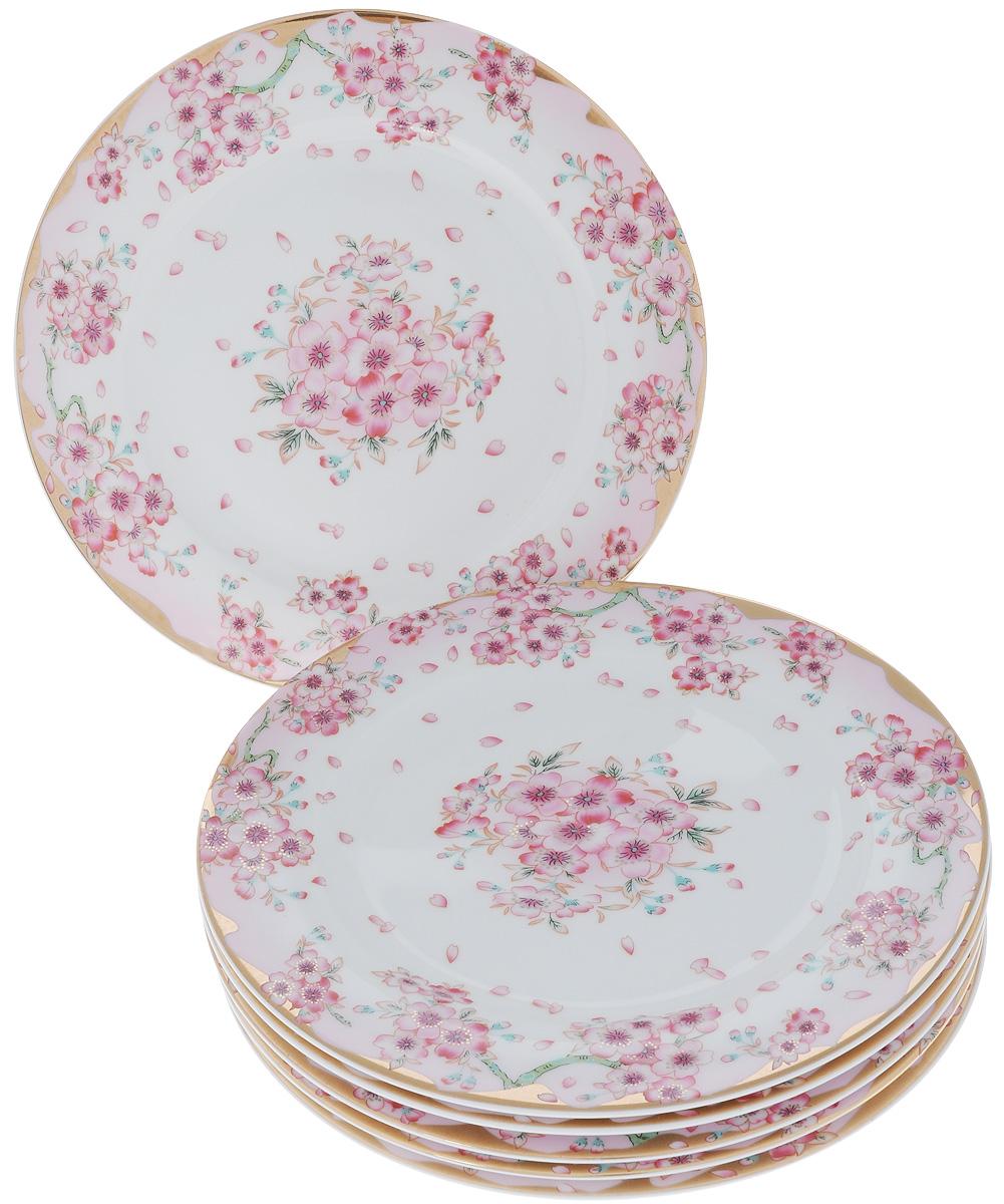Набор обеденных тарелок Elan Gallery Сакура, диаметр 23 см, 6 шт503621Набор Elan Gallery Сакура, выполненный из высококачественной керамики, состоит из 6 обеденных тарелок и предназначен для красивой сервировки различных блюд. Изделия украшены цветочным рисунком. Набор сочетает в себе стильный дизайн с максимальной функциональностью. Оригинальность оформления придется по вкусу и ценителям классики, и тем, кто предпочитает утонченность и изящность. Не использовать в микроволновой печи. Диаметр по верхнему краю: 23 см.