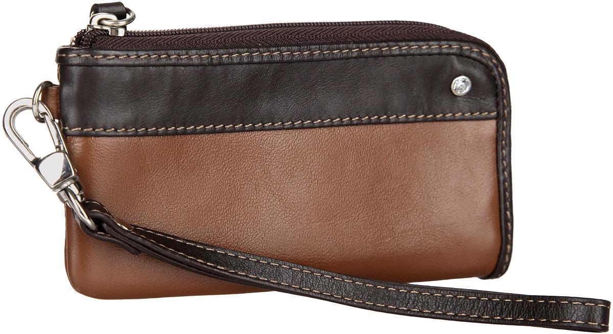 Ключница Leo Ventoni, цвет: коричневый, темно-коричневый. L330210-06L330210-06Стильная ключница Leo Ventoni выполнена из натуральной кожи. Лицевая сторона изделия оформлена сияющим кристаллом. Изделие застегивается на застежку-молнию. Внутри расположено кольцо для ключей и накладной кармашек. Снаружи, в задней стенке изделия, расположен прорезной карман на застежке-молнии. Изделие оснащено съемным ремешком с карабином. Оригинальная ключница Leo Ventoni станет отличным подарком для человека, ценящего качественные и практичные вещи.