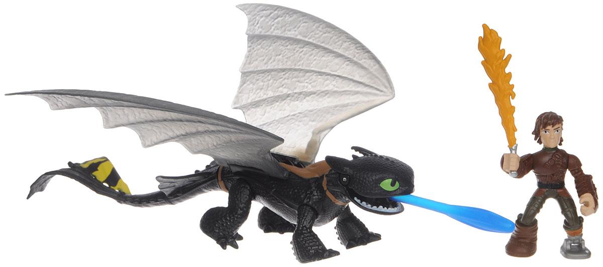 Dragons Игровой набор Hiccup & Toothless цвет черный желтый66594_20071832Игровой набор Dragons Hiccup & Toothless обязательно понравится вашему ребенку. Он включает фигурку дракона Беззубика, фигурку Иккинга и меч для сражений, отлично помещающийся ему в руку. Фигурки героя и дракона выполнены из прочного пластика и устойчивы к повреждениям. Фигурку Иккинга можно посадить на Беззубика и устраивать незабываемые полеты. Дракон может поднимать крылья и открывать пасть. Из пасти Беззубика вылетает стрела. Порадуйте вашего ребенка таким замечательным подарком!