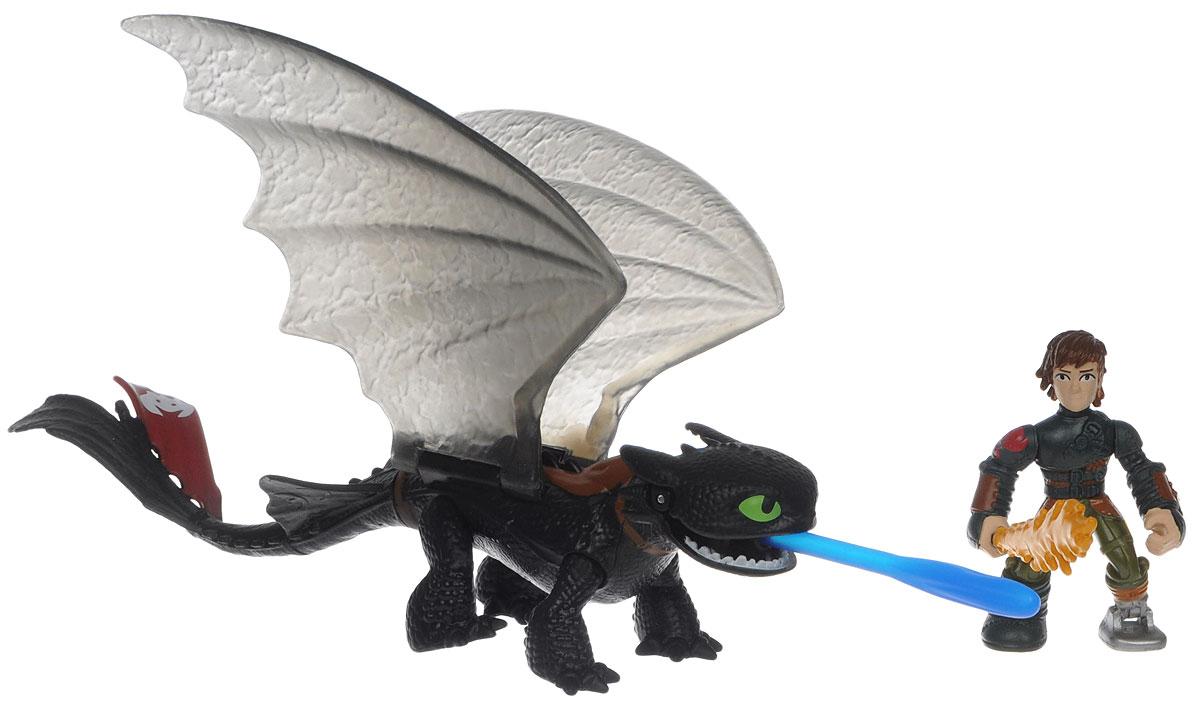 Dragons Игровой набор Hiccup & Toothless цвет черный красный66594_20067363Игровой набор Dragons Hiccup & Toothless обязательно понравится вашему ребенку. Он включает фигурку дракона Беззубика, фигурку Иккинга и меч для сражений, отлично умещающийся ему в руку. Фигурки героя и дракона выполнены из прочного пластика и устойчивы к повреждениям. Фигурку Иккинга можно посадить на Беззубика и устраивать незабываемые полеты. Дракон может поднимать крылья и открывать пасть. Из пасти Беззубика вылетает стрела. Порадуйте вашего ребенка таким замечательным подарком!