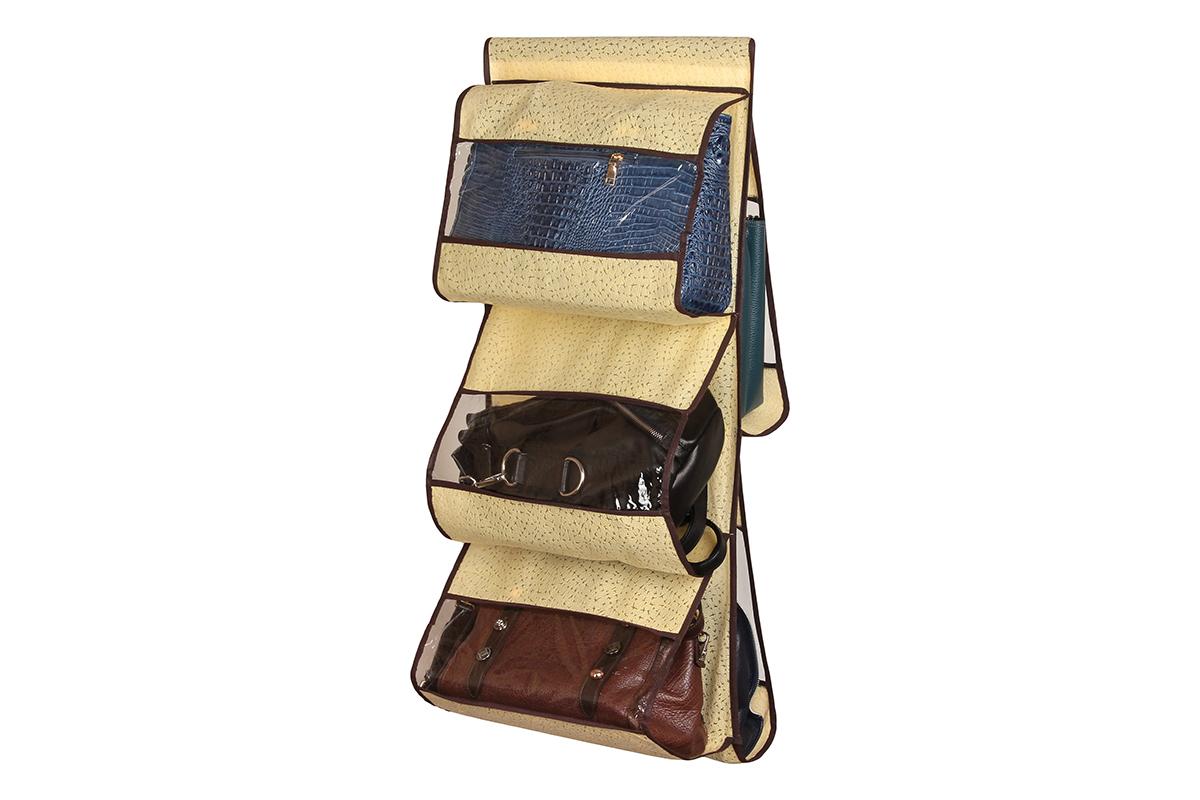 Кофр подвесной для сумок El Casa Звезды, цвет: желтый , 5 секций, 39 х 90 см370200Подвесной кофр El Casa Звезды изготовлен из высококачественного нетканого волокна, которое позволяет воздуху проникать внутрь, при этом надежно защищая вещи от грязи, пыли, солнечных лучей и насекомых. В шкафу всегда будет порядок, так как такой кофр не только очень компактен, но и, несмотря на свои размеры, вмещает множество вещей. Пять прозрачных секций, расположенных с двух сторон, позволят вам удобно разместить свои сумочки, полотенца, зонтики и многое другое в легкодоступном месте. Изделие снабжено широкой петлей на липучках, с помощью которой крепится к перекладине.