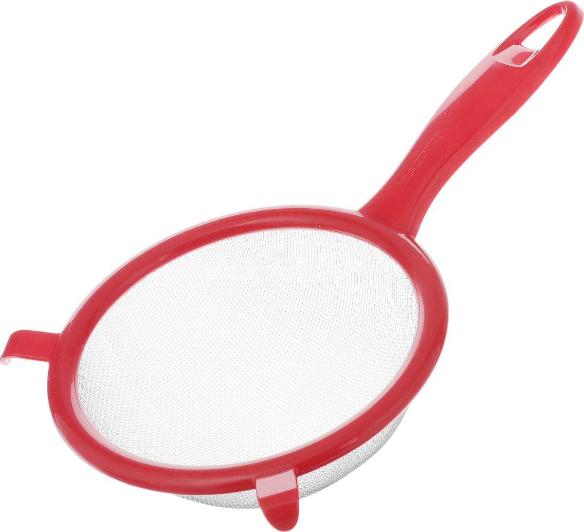 Сито Tescoma Presto, цвет: красный, диаметр 14 см420604_ красныйСито Tescoma Presto изготовлено из высококачественной нержавеющей стали и прочного пластика. Изделие снабжено двумя выступами для установки на кастрюлю. Ручка снабжена отверстием для подвешивания на крючок. Сито предназначено для процеживания круп и макарон, просеивания муки, промывания ягод и фруктов. Такое сито станет незаменимым аксессуаром на вашей кухне. Можно мыть в посудомоечной машине. Диаметр сита: 14 см. Длина (с учетом ручки): 25 см.