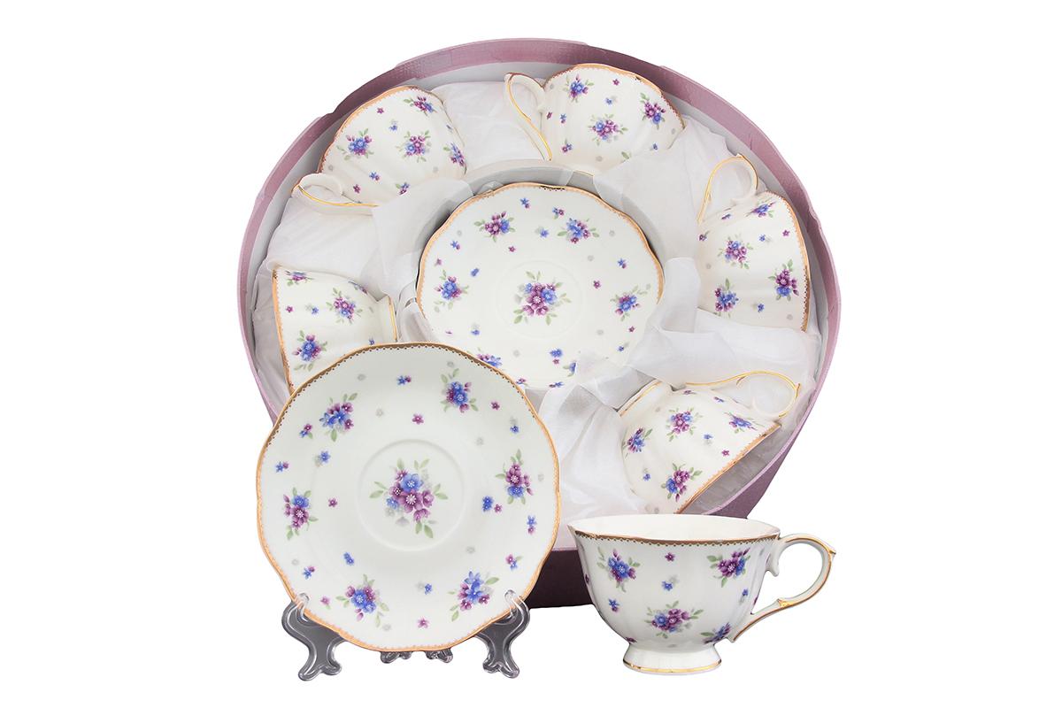 Набор чайный Elan Gallery Сиреневый туман, 12 предметов420084Чайный набор Elan Gallery Сиреневый туман состоит из 6 чашек и 6 блюдец. Изделия, выполненные из высококачественной керамики, оформлены изысканным изображением цветов и декорированы золотистой каймой. Такой набор прекрасно подойдет как для повседневного использования, так и для праздников. Чайный набор Elan Gallery Сиреневый туман - это не только яркий и полезный подарок для родных и близких, это также великолепное дизайнерское решение для вашей кухни или столовой. Не рекомендуется применять абразивные моющие средства. Не использовать в микроволновой печи. Объем чашки: 250 мл. Диаметр чашки (по верхнему краю): 10,5 см. Высота чашки: 7 см. Диаметр блюдца (по верхнему краю): 15,2 см. Высота блюдца: 2,2 см.