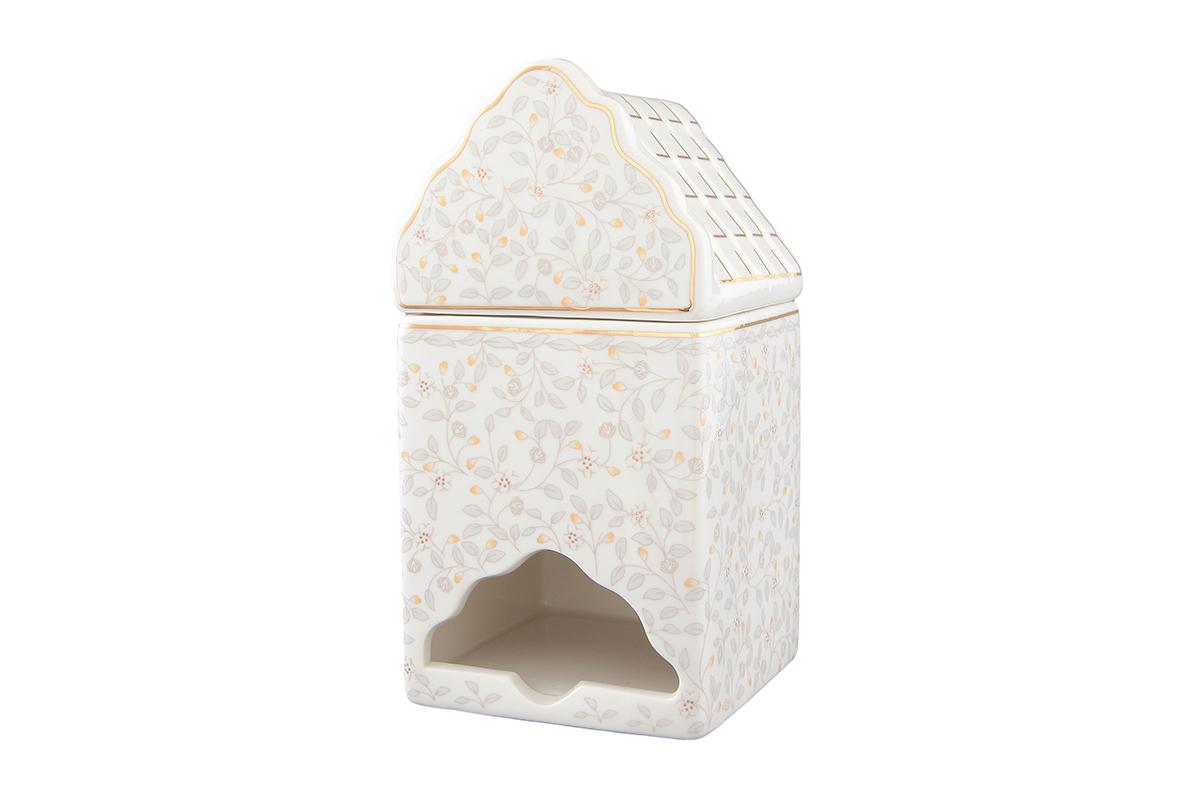 Банка-домик для чайных пакетиков Elan Gallery Ситец503810Банка-домик для чайных пакетиков Elan Gallery Ситец изготовлена из высококачественной керамики в виде домика, украшенного цветочным рисунком. Банка оснащена удобной крышечкой и отверстием снизу, с помощью которого удобно доставать чайные пакетики. Такая оригинальная банка для хранения красиво оформит кухонный стол и удивит вас своей функциональностью. Размер банки-домика: 8,5 см х 8 см х 16,5 см.