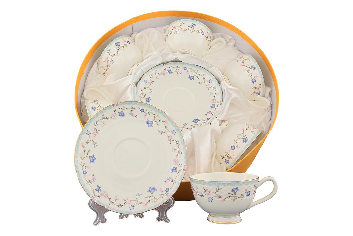 Набор чайный Elan Gallery Нежное утро, 12 предметов530047Чайный набор Elan Gallery Нежное утро состоит из 6 чашек и 6 блюдец. Изделия, выполненные из высококачественной керамики, украшены изысканным изображением цветов и декорированы золотистой каймой. Такой набор прекрасно подойдет как для повседневного использования, так и для праздников. Чайный набор Elan Gallery Нежное утро - это не только яркий и полезный подарок для родных и близких, это также великолепное дизайнерское решение для вашей кухни или столовой. Не рекомендуется применять абразивные моющие средства. Не использовать в микроволновой печи. Объем чашки: 230 мл. Диаметр чашки (по верхнему краю): 10 см. Высота чашки: 6,4 см. Диаметр блюдца (по верхнему краю): 16 см. Высота блюдца: 2 см.