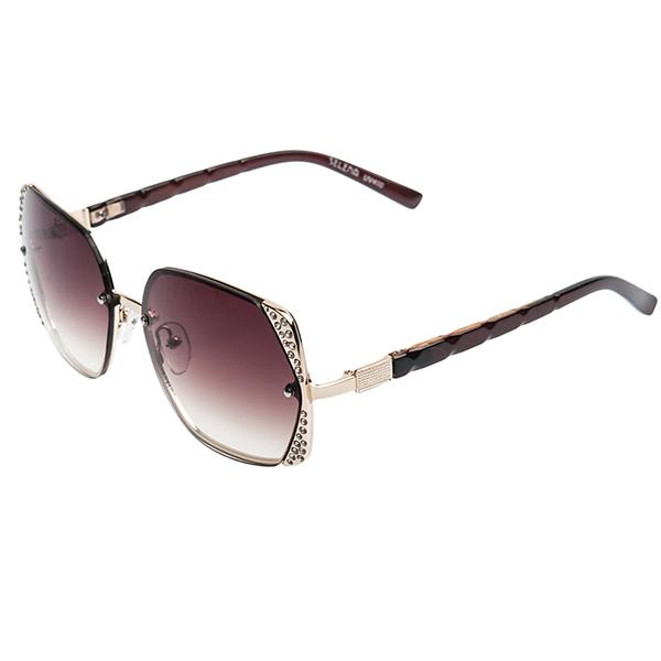 Солнцезащитные очки женские Selena, цвет: коричневый, золотой. 8002457180024571Солнцезащитные женские очки Selena выполнены из металла с элементами из высококачественного пластика, оправа инкрустирована стразами. Линзы данных очков с высокоэффективным фильтром UV-400 Protection обеспечивают полную защиту от ультрафиолетовых лучей. Используемый пластик не искажает изображение, не подвержен нагреванию и вредному воздействию солнечных лучей. Такие очки защитят глаза от ультрафиолетовых лучей, подчеркнут вашу индивидуальность и сделают ваш образ завершенным.