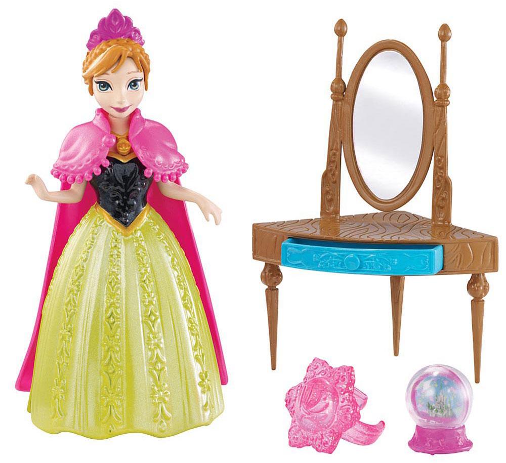 Disney Frozen Игровой набор с мини-куклой АннаY9972_Y9973Игровой набор с мини-куклой Анна непременно порадует вашу малышку и доставит ей много удовольствия от часов, посвященных игре с ней. Куколка выполнена в виде героини диснеевского мультфильма Холодное сердце. Она одета в яркое платье и розовую накидку, на голове у Анны - корона. Платье куколки выполнено по специальной технологии MagiClip из мягкого пластика, которая позволяет его легко снимать и надевать. Ручки, ножки и голова куклы подвижны. В комплекте с Анной есть туалетный столик с зеркалом и ящичком. На столик можно поставить прозрачную игрушку-шар. А для маленькой хозяйки куклы есть сюрприз - замечательное розовое колечко! Ваша малышка с удовольствием будет играть с этой куколкой, проигрывая сюжеты из мультфильма, или придумывая различные истории.