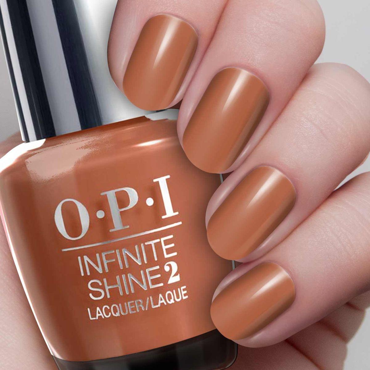 """OPI Infinite Shine Лак для ногтей Brains & Bronze,15 млISL23""""Линия Infinite Shine была разработана в ответ на желание покупателей получить лаковые покрытия, по свойствам не уступающие гелевым, которые при этом имели бы самые модные оттенки, обладали уникальной формулой и носили культовые имена, которыми так знаменита компания OPI,"""" - объясняет Сюзи Вайс-Фишманн, соучредитель и исполнительный вице-президент OPI. """"Покрытие Infinite Shine наносится и снимается точно так же, как и обычные лаки для ногтей, однако вы получаете те самые блеск и стойкость, которые отличают гелевую формулу!"""" Палитра Infinite Shine включает в себя широкий спектр оттенков, от нейтральных до ярко-красных, оранжевых, розовых, а далее до темно-серых, синих и черного. Лаки Infinite Shine имеют запатентованную формулу. Каждый флакон снабжен эксклюзивной кистью ProWide™ для идеального нанесения."""