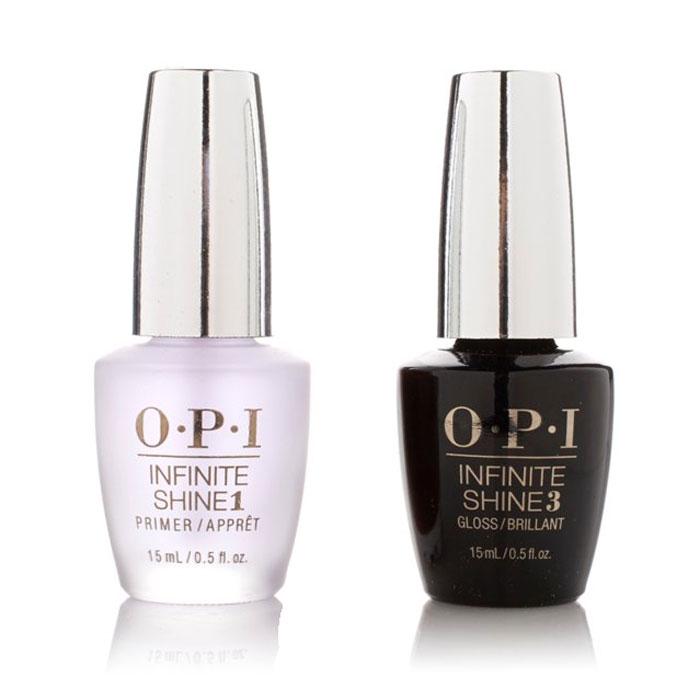 """OPI Набор Infinite Shine Duo Pack (IST10+IST30, 2*15 мл)SRG35""""Линия Infinite Shine была разработана в ответ на желание покупателей получить лаковые покрытия, по свойствам не уступающие гелевым, которые при этом имели бы самые модные оттенки, обладали уникальной формулой и носили культовые имена, которыми так знаменита компания OPI,"""" - объясняет Сюзи Вайс-Фишманн, соучредитель и исполнительный вице-президент OPI. """"Покрытие Infinite Shine наносится и снимается точно так же, как и обычные лаки для ногтей, однако вы получаете те самые блеск и стойкость, которые отличают гелевую формулу!"""" Палитра Infinite Shine включает в себя широкий спектр оттенков, от нейтральных до ярко-красных, оранжевых, розовых, а далее до темно-серых, синих и черного. Лаки Infinite Shine имеют запатентованную формулу. Каждый флакон снабжен эксклюзивной кистью ProWide™ для идеального нанесения."""