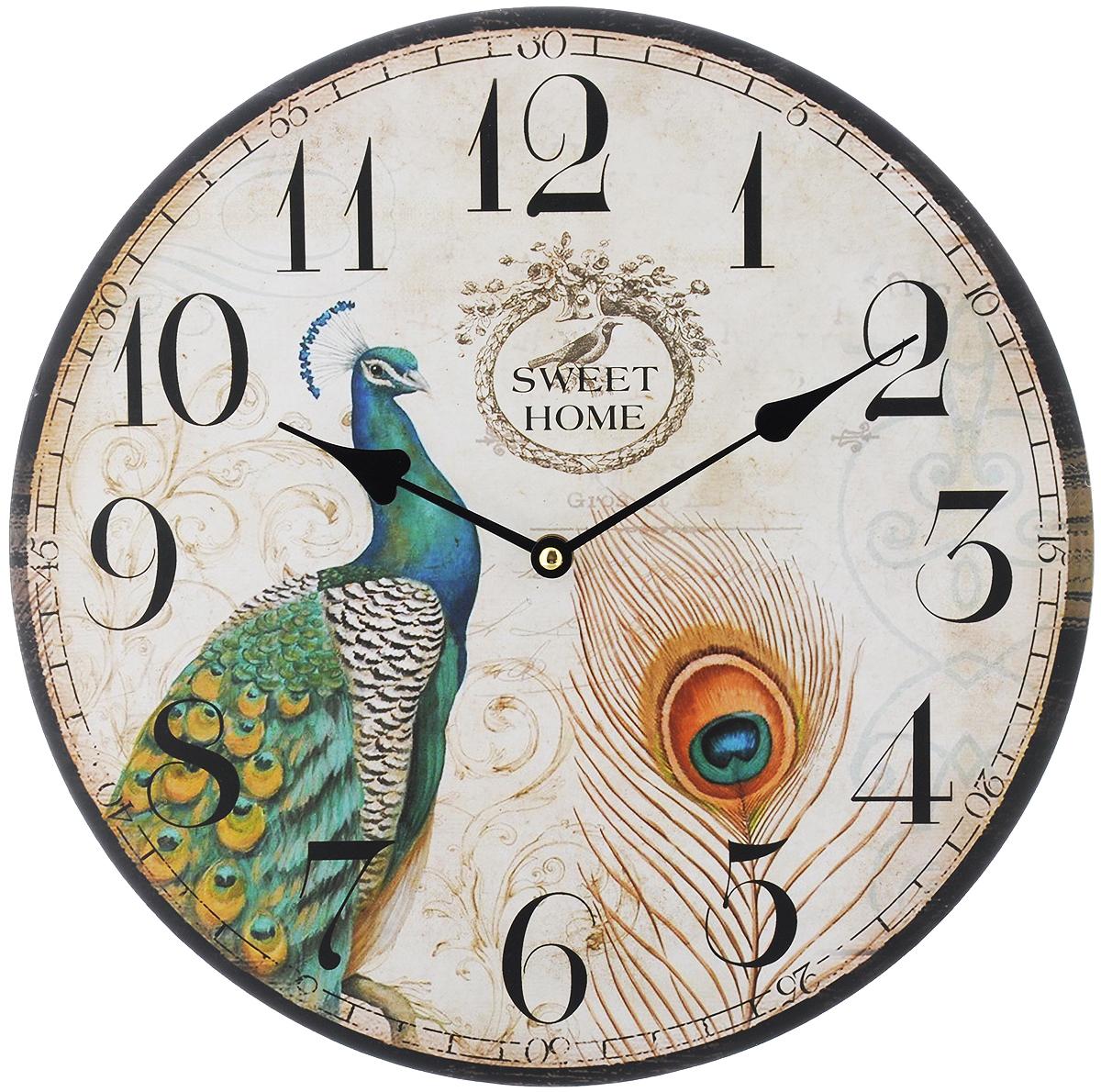 Часы настенные Феникс-Презент Павлин, диаметр 34 см40710Настенные часы круглой формы Феникс-Презент Павлин своим эксклюзивным дизайном подчеркнут оригинальность интерьера вашего дома. Циферблат оформлен изображением изящного павлина. Часы выполнены из МДФ. МДФ (мелкодисперсные фракции) представляет собой плиту из запрессованной вакуумным способом деревянной пыли и является наиболее экологически чистым материалом среди себе подобных. Часы имеют две стрелки - часовую и минутную. Настенные часы Феникс-Презент Павлин подходят для кухни, гостиной, прихожей или дачи, а также могут стать отличным подарком для друзей и близких. ВНИМАНИЕ!!! Часы работают от сменной батареи типа АА 1,5V (в комплект не входит).