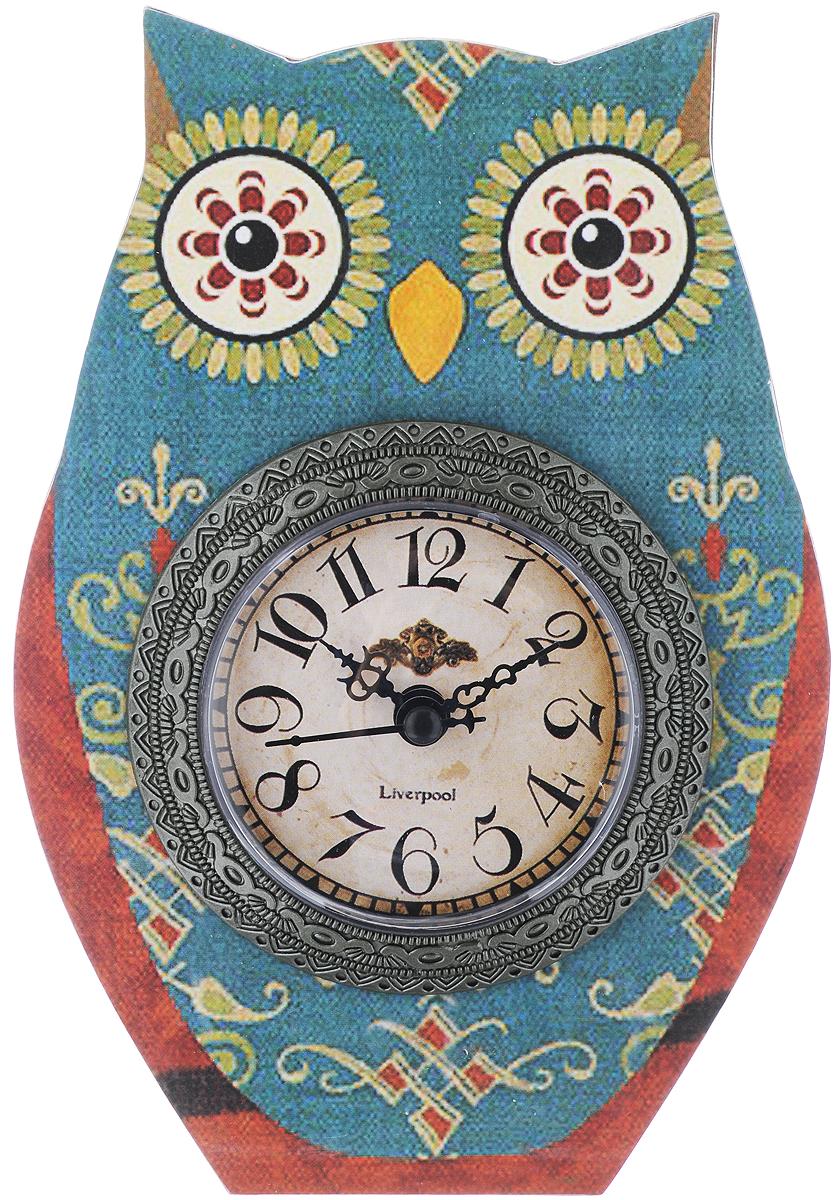 Часы настольные Феникс-Презент Совушкины чары, 15 х 20 см40735Настольные часы Феникс-Презент Совушкины чары своим эксклюзивным дизайном подчеркнут оригинальность интерьера вашего дома. Часы выполнены из МДФ в виде совы. МДФ (мелкодисперсные фракции) представляет собой плиту из запрессованной вакуумным способом деревянной пыли и является наиболее экологически чистым материалом среди себе подобных. Часы имеют три стрелки - секундную, часовую и минутную. Настольные часы Феникс-Презент Совушкины чары подходят для кухни, гостиной, прихожей или дачи, а также могут стать отличным подарком для друзей и близких. ВНИМАНИЕ!!! Часы работают от сменной батареи типа АА 1,5V (в комплект не входит).