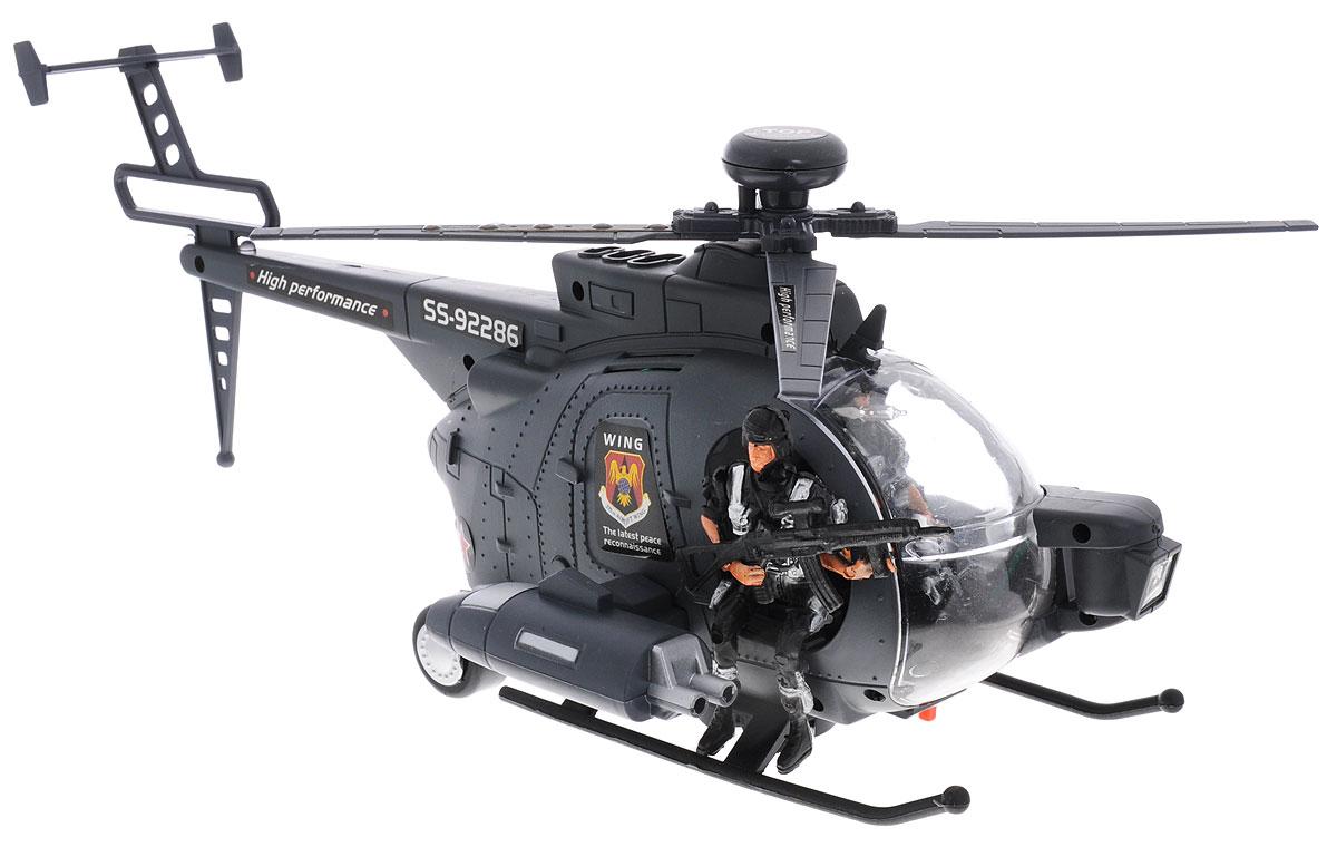 Junfa Toys Вертолет Black Hawk92286Вертолет Junfa Toys Black Hawk станет отличным подарком для любого мальчика! Вертолет с пилотом и снайпером выполнен из прочного пластика и хорошо детализирован. При включении игрушки лопасти вертолета вращаются, он начинает кататься по полу в разных направлениях. Работа вертолета сопровождается световыми и звуковыми эффектами: имеется подсветка пропеллера, кабины, светится прожектор и сигнальный огонек в хвосте. Воспроизводятся звуки работающего двигателя, стрельбы. Для работы игрушки необходимы 4 батарейки типа АА (не входят в комплект).