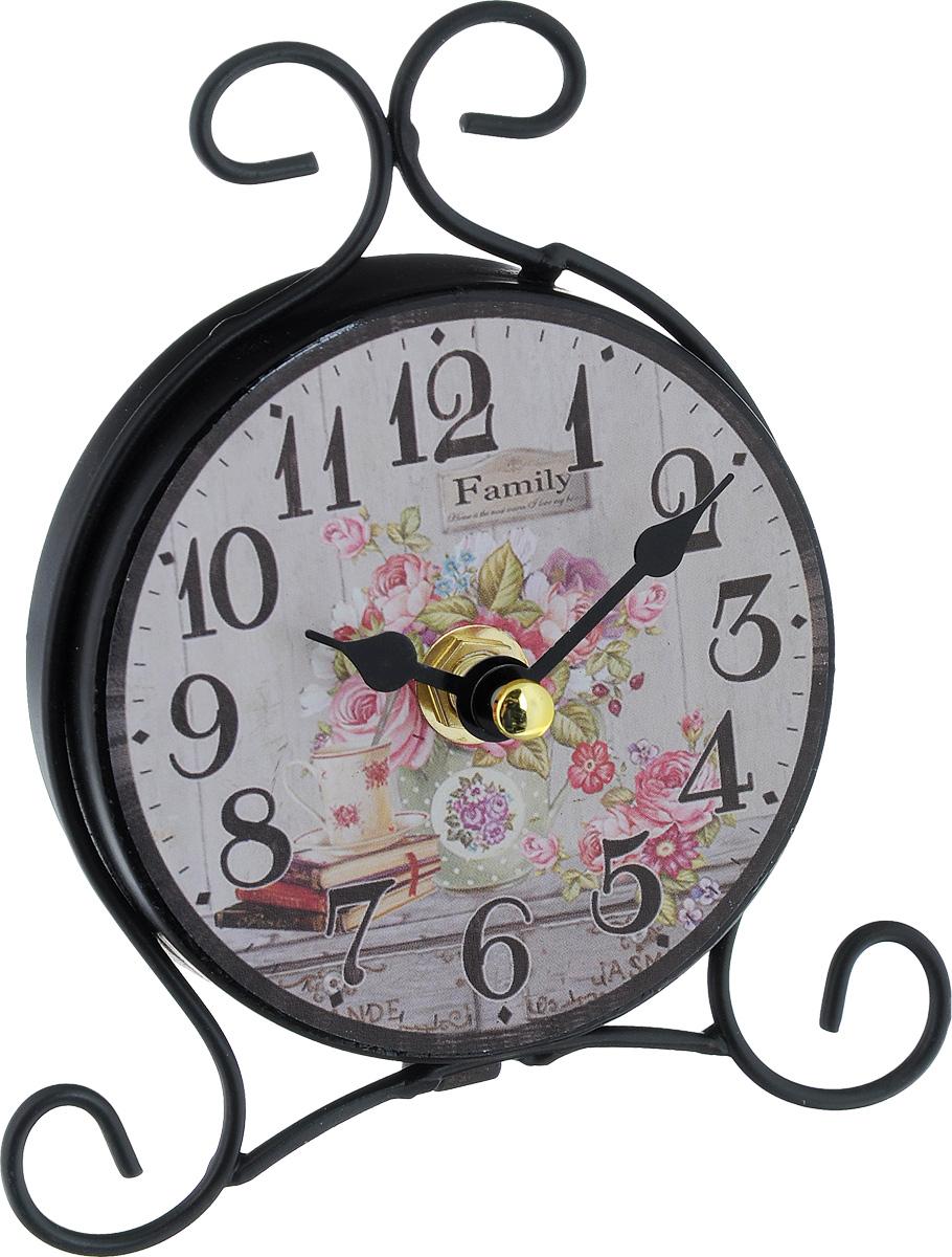 Часы настольные Феникс-Презент Книжный уголок40741Настольные часы Феникс-Презент Книжный уголок своим эксклюзивным дизайном подчеркнут оригинальность интерьера вашего дома. Изделие выполнено из металла и оформлено изображением книг и вазы с цветами. Часы имеют две стрелки - часовую и минутную. Настольные часы Феникс-Презент Книжный уголок подходят для кухни, гостиной, прихожей или дачи, а также могут стать отличным подарком для друзей и близких. ВНИМАНИЕ!!! Часы работают от сменной батареи типа АА 1,5V (в комплект не входит).