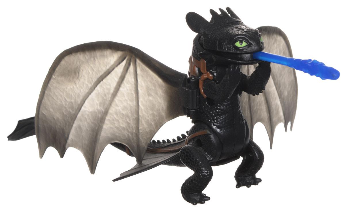Игрушка Dragons Функциональные драконы: Toothless. 66550_2006460866550_20064608Игрушка Dragons Функциональные драконы: Toothless непременно придется по душе вашему ребенку. Игрушка выполнена в виде дракона Беззубика из популярного мультфильма Как приручить дракона. Крылья, голова, лапы и хвост дракона подвижны. Если вставить снаряд в пасть игрушки, а затем опустить дракона на передние лапы, Беззубик атакует снарядом врага. С драконом можно организовать настоящее сражение, ведь эти умелые бойцы снабжены всем необходимым для настоящей схватки с противником! Благодаря игрушке Dragons Функциональные драконы: Toothless ваш ребенок с удовольствием будет проигрывать любимые сцены из мультфильма или придумывать свои истории!