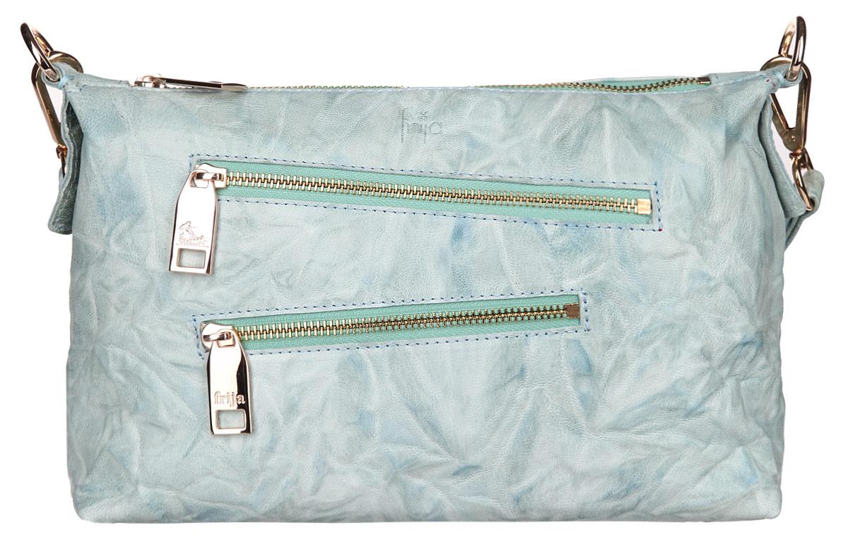 Сумка женская Frija, цвет: голубой. 21-0305-1521-0305-15Стильная женская сумка Frija выполнена из натуральной кожи с фактурным тиснением, оформлена металлической фурнитурой и тиснением с символикой бренда. Изделие содержит одно отделение, которое закрывается на молнию. Внутри расположены два накладных кармашка для мелочей и врезной карман на молнии. Снаружи, на лицевой стороне изделия, расположены два врезных кармана, каждый из которых закрывается на молнию. На задней стороне сумки расположен врезной карман на застежке-молнии. Сумка оснащена практичной съемной лямкой для переноски. Оригинальный аксессуар позволит вам завершить образ и быть неотразимой.