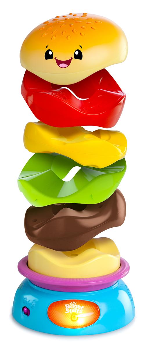 Bright Starts Развивающая игрушка-пирамидка Веселый бутерброд52126Развивающая игрушка-пирамидка Bright Starts Веселый бутерброд сделает игру малыша еще увлекательнее! Классическая пирамидка теперь в новой форме - в виде бутерброда. Пирамидка состоит из 5 колечек, которые удобно держать маленькими ручками. Яркие разноцветные колечки можно укладывать в любом порядке, создавая свою версию бутерброда. Уникальная форма колечек позволяет складывать их без стержня-подставки. Если нажать на кнопочку, веселый бутерброд начнет крутиться под веселую музыку и мигать огоньком, пока все колечки не разлетятся в разные стороны. Игрушка стимулирует мелкую моторику, цветовое и звуковое восприятие, тактильную чувствительность. Для детей от 6 до 36 месяцев. Для работы игрушки необходимы 3 батарейки типа АА (товар комплектуется демонстрационными).