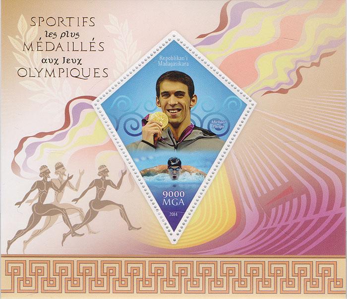 Почтовый блок Михаэль Фелпс из серии Олимпийские чемпионы. Мадагаскар, 2014 год739Почтовый блок Михаэль Фелпс из серии Олимпийские чемпионы. Мадагаскар, 2014 год. Размер блока: 11 х 13 см. Размер марок: 8 х 6 см. Сохранность хорошая.
