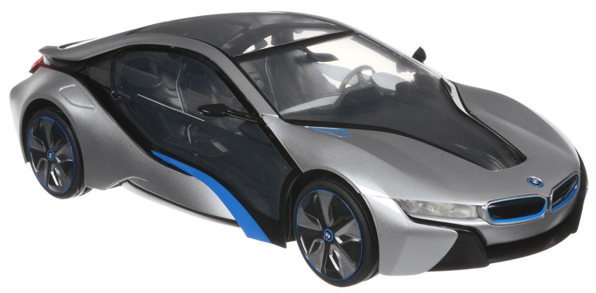 Rastar Радиоуправляемая модель BMW i8 цвет серебристый черный49600-11_серебристый, черныйРадиоуправляемая модель Rastar BMW I8 станет отличным подарком любому мальчику! Все дети хотят иметь в наборе своих игрушек ослепительные, невероятные и крутые автомобили на радиоуправлении. Тем более, если это автомобиль известной марки с проработкой всех деталей, удивляющий приятным качеством и видом. Одной из таких моделей является автомобиль на радиоуправлении Rastar BMW I8. Это точная копия настоящего авто в масштабе 1:14. Авто обладает неповторимым провокационным стилем и спортивным характером. Потрясающая маневренность, динамика и покладистость - отличительные качества этой модели. Возможные движения: вперед, назад, вправо, влево, остановка. Имеются световые эффекты. Аккуратно нажмите на заднюю часть кузова автомобиля для включения и отключения передних или задних фар, а также подсветки салона. Пульт управления работает на частоте 40 MHz. Для работы машины необходимы 5 батареек типа АА (не входят в комплект). Для работы...