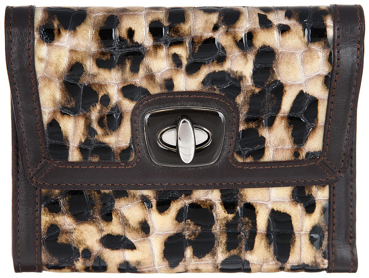 Кошелек женский Leo Ventoni, цвет: темно-коричневый, бежевый, черный. L330341-06L330341-06 pitonМодный женский кошелек Leo Ventoni выполнен из натуральной кожи с фактурной поверхностью, оформленной оригинальным принтом, и дополнен по краям отделкой из кожи контрастного цвета. Внутри - три отделения для купюр, шесть кармашков для кредитных карт или визиток и один карман с прозрачным пластиковым окошком. Сзади расположен карман на металлической молнии для мелочи, который состоит из двух отсеков, разделенных перегородкой. Подкладка исполнена из полиэстера. Изделие закрывается клапаном на замок- вертушку. Кошелек упакован в коробку из плотного картона с логотипом фирмы. Такой кошелек станет замечательным подарком человеку, ценящему качественные и практичные вещи.