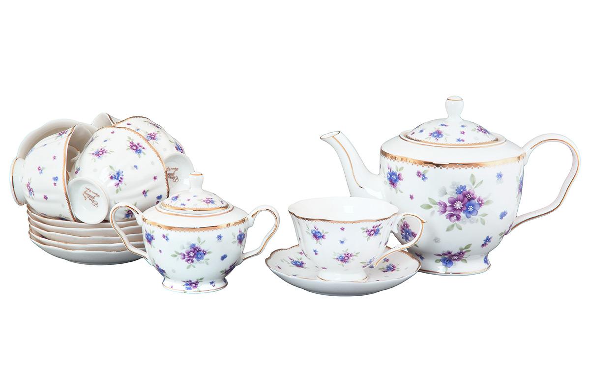 Набор чайный Elan Gallery Сиреневый туман, 14 предметов420085Чайный набор Elan Gallery Сиреневый туман состоит из 6 чашек, 6 блюдец, сахарницы и заварочного чайника. Изделия, выполненные из высококачественной керамики, имеют элегантный дизайн и классическую форму. Такой набор прекрасно подойдет как для повседневного использования, так и для праздников. Чайный набор Elan Gallery Сиреневый туман - это не только яркий и полезный подарок для родных и близких, а также великолепное решение для вашей кухни или столовой. Не использовать в микроволновой печи. Объем чашки: 250 мл. Диаметр чашки (по верхнему краю): 10,5 см. Высота чашки: 7 см. Диаметр блюдца (по верхнему краю): 15 см. Высота блюдца: 2,5 см. Высота чайника (без учета ручки и крышки): 13 см. Объем чайника: 1,4 л. Диаметр сахарницы (по верхнему краю): 7 см. Высота сахарницы (без учета крышки): 8 см.