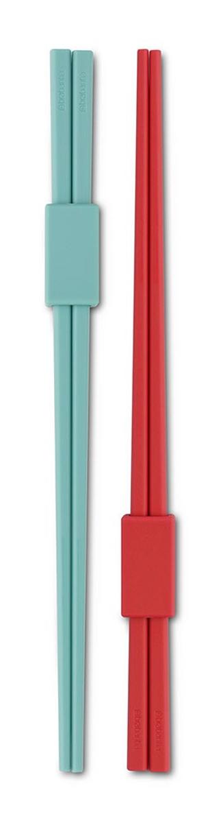 Палочки для суши Brabantia Tasty Colours, 4 шт108242Стильные палочки для суши Brabantia Tasty Colours, выполненные из высококачественного цветного пластика, помогут создать особую атмосферу восточной кухни. В набор входят: две пары палочек, скрепленных специальным фиксатором, который может использоваться как удобная подставка, гарантирующая гигиеничность и отсутствие пятен на вашей скатерти. Можно мыть в посудомоечной машине. Длина палочки: 22 см. Размер фиксатора: 3 х 1,5 х 1 см.