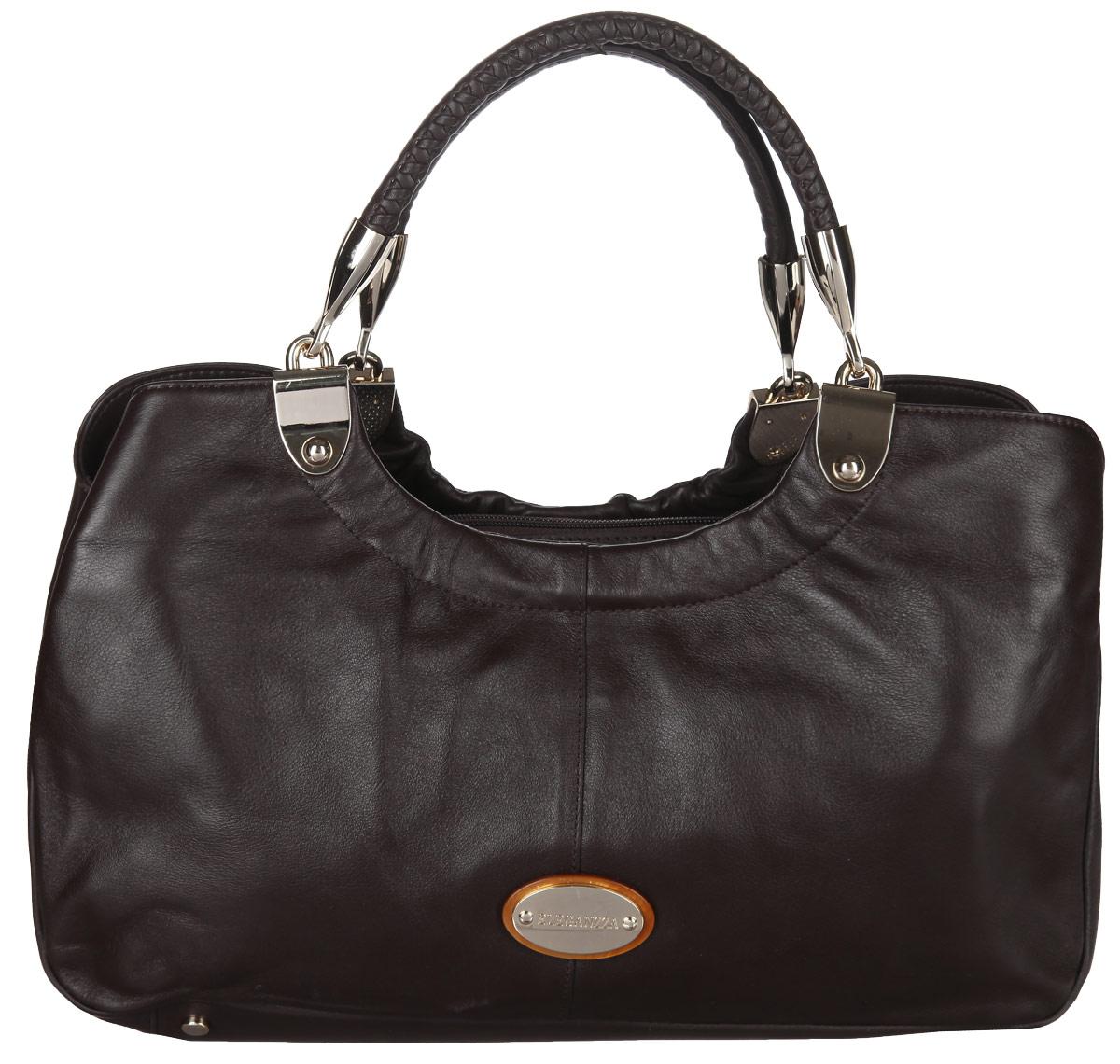 Сумка женская Eleganzza, цвет: коричневый. ZB-5318ZB-5318Стильная сумка Eleganzza изготовлена из натуральной кожи с зернистой фактурой, оформлена металлической фурнитурой с символикой бренда. Изделие содержит три отделения, два из которых закрываются на магнитные кнопки, а третье на застежку-молнию. Внутри расположен врезной карман на молнии. Изделие оснащено двумя практичными ручками, которые оформлены металлической фурнитурой и съемным плечевым ремнем регулируемой длины. Дно изделия дополнено металлическими ножками. Оригинальный аксессуар позволит вам завершить образ и быть неотразимой.