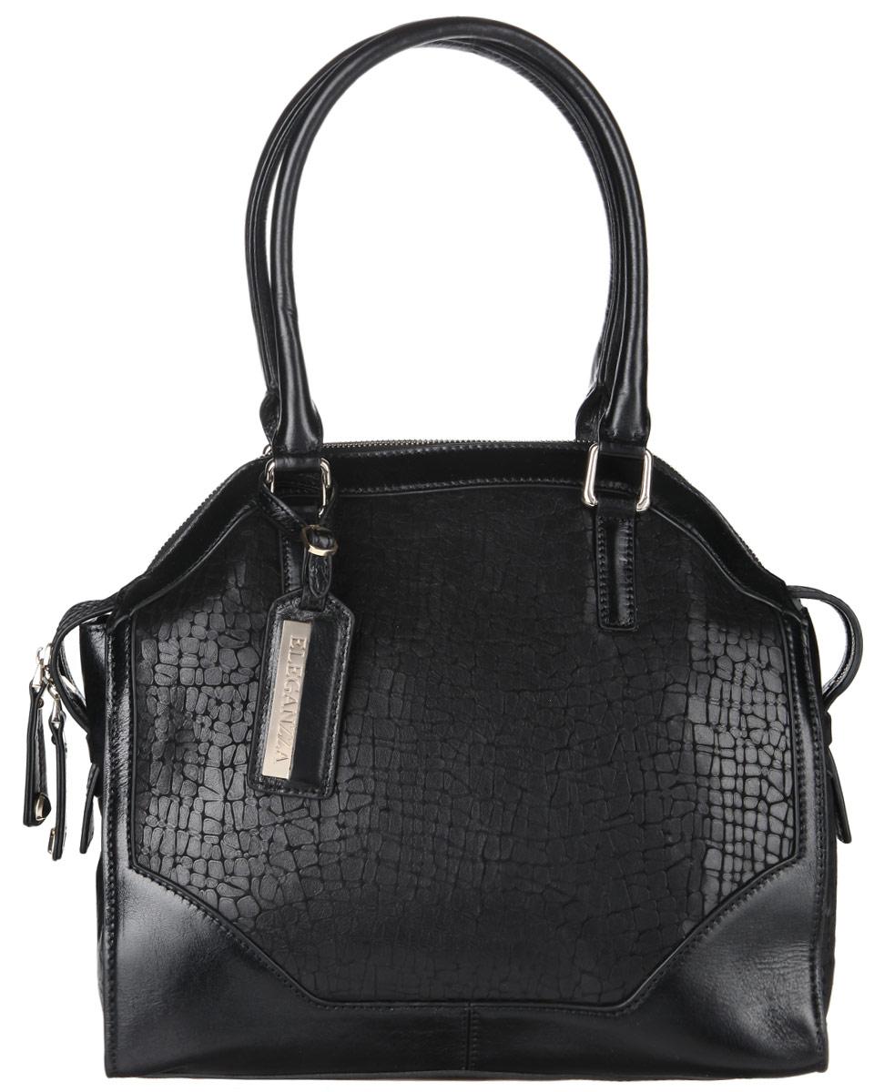 Сумка женская Eleganzza, цвет: черный. Z276-7515MZ276-7515MСтильная сумка Eleganzza, изготовлена из натуральной кожи с зернистой фактурой, оформлена кожаными вставками с декоративным тиснением и оригинальной подвеской. Изделие содержит одно отделение, которое закрывается на застежку-молнию. Внутри изделия расположены два накладных кармашка для мелочей, врезной карман на молнии и карман-средник на молнии. Задняя сторона изделия дополнена врезным карманом на молнии. Изделие оснащено двумя практичными ручками, которые дополнены металлической фурнитурой. На дне сумки размещены металлические ножки, которые защитят дно от преждевременного изнашивания. Оригинальный аксессуар позволит вам завершить образ и быть неотразимой.
