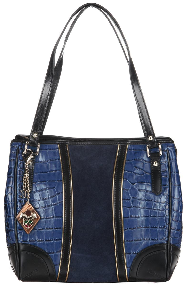 Сумка женская Eleganzza, цвет: синий. Z15-3246MZ15-3246MСтильная сумка Eleganzza, изготовлена из натуральной кожи с фактурным тиснением под кожу рептилии, оформлена вставкой из замши и оригинальной подвеской. Изделие содержит одно отделение, которое закрывается на застежку-молнию. Внутри изделия расположены два накладных кармашка для мелочей, врезной карман на молнии и карман-средник на молнии. Задняя сторона изделия дополнена врезным карманом на молнии. Изделие оснащено двумя практичными ручками. На дне сумки размещены металлические ножки, которые защитят дно от преждевременного изнашивания. Оригинальный аксессуар позволит вам завершить образ и быть неотразимой.