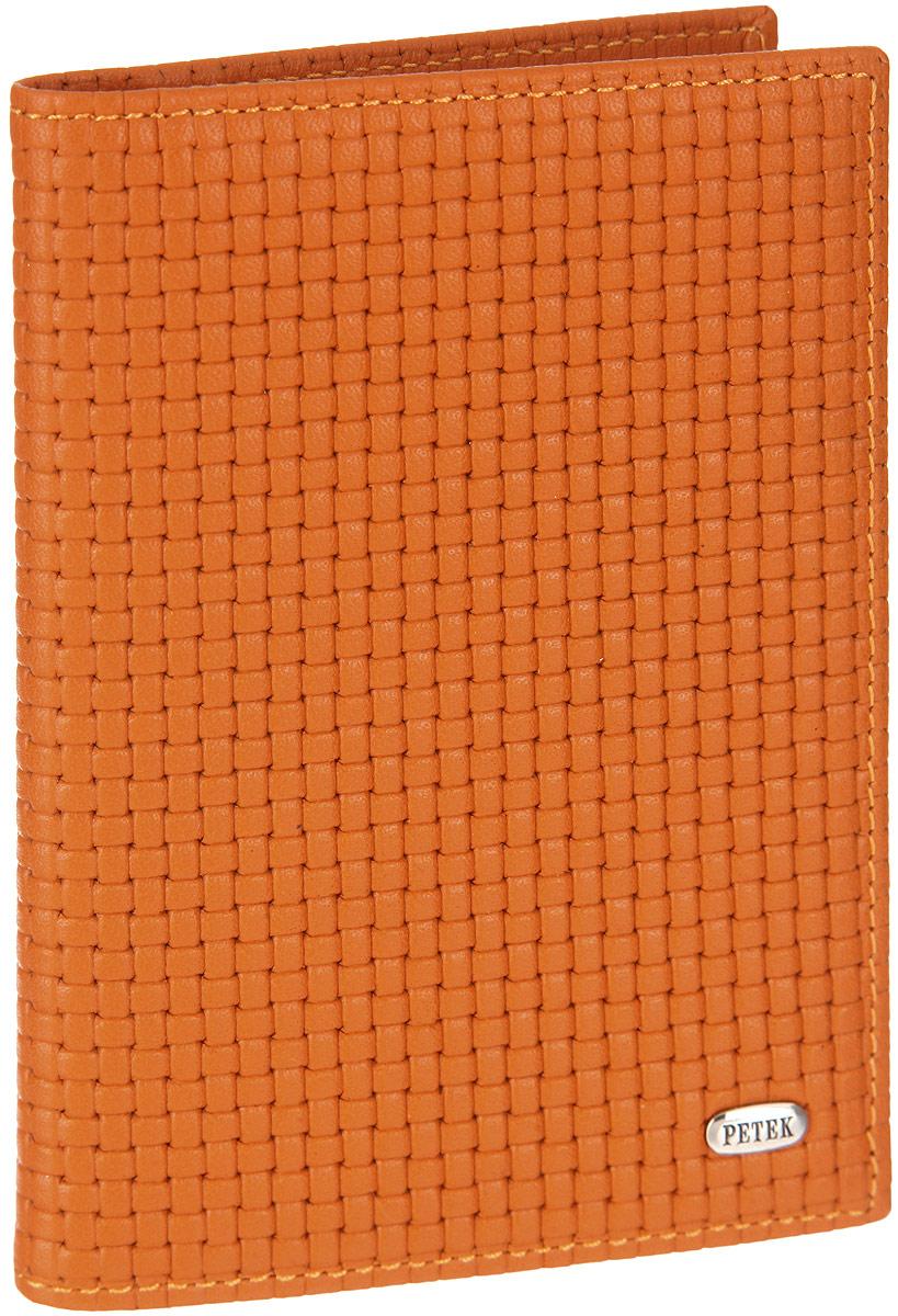 Обложка для автодокументов женская Petek 1855, цвет: ярко-оранжевый. 584.020.89584.020.89 Orange PopsicleОбложка для автодокументов Petek изготовлена из натуральной кожи с оригинальным фактурным тиснением, оформлена металлической фурнитурой с символикой бренда. Изделие раскладывается пополам. Внутри расположены четыре прорезных кармана для кредитных карт, сетчатый кармашек, потайной кармашек, вкладыш для автодокументов, состоящий из шести файлов, один из которых формата А5. Изделие поставляется в фирменной упаковке. Обложка для автодокументов поможет сохранить внешний вид ваших документов и защитить их от повреждений, а также станет стильным аксессуаром.