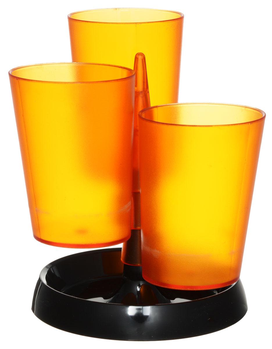 Centrum Подставка для канцелярских принадлежностей цвет оранжевый83904_оранжевыйПодставка для канцелярских принадлежностей Centrum - неотъемлемый атрибут рабочего стола дома или в офисе. Подставка изготовлена из высококачественного пластика и имеет 3 отделения в виде стаканов, которые собираются на подставку. Подставка выполнена из непрозрачного пластика и благодаря широкому дну обеспечивает необходимую устойчивость. Такая подставка станет практичным и функциональным элементом вашего рабочего стола, благодаря ей канцелярские принадлежности всегда будут под рукой.
