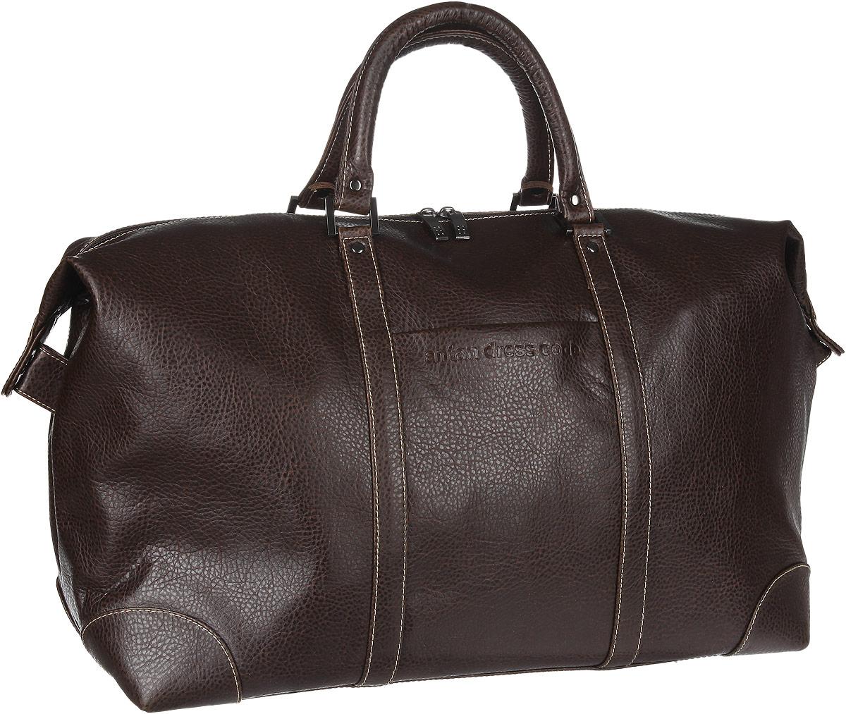 Сумка дорожная Antan, цвет: темно-коричневый. 2-2072-207Стильная дорожная сумка Antan изготовлена из искусственной кожи с зернистой фактурой, оформлена тиснением в виде логотипа бренда. Сумка содержит одно вместительное отделение, закрывающееся на застежку-молнию. Внутри расположен врезной карман на застежке-молнии. Снаружи, на лицевой стороне сумки, расположен накладной кармашек. Сумка оснащена двумя удобными ручками и съемным наплечным ремнем регулируемой длины. Дно изделия дополнено металлическими ножками. Практичная сумка станет незаменимым аксессуаром для путешествий.