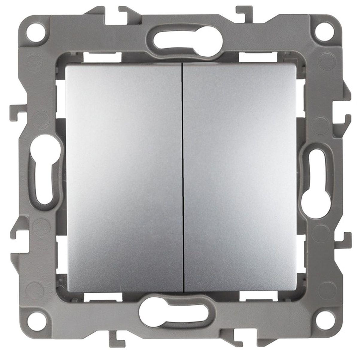 Выключатель ЭРА, двойной, цвет: серый. 12-100412-1004-03Двойной выключатель ЭРА выполнен из прочного пластика, контакты бронзовые. Изделие просто в установке, надежно в эксплуатации. Выключатель имеет специальные фиксаторы, которые не дают ему смещаться как при монтаже, так и в процессе эксплуатации. Автоматические зажимы кабеля обеспечивают быстрый и надежный монтаж изделия к электросети без отвертки и не требуют обслуживания в отличие от винтовых зажимов. УВАЖАЕМЫЕ КЛИЕНТЫ! Обращаем ваше внимание на тот факт, что монтажные лапки в комплект не входят.