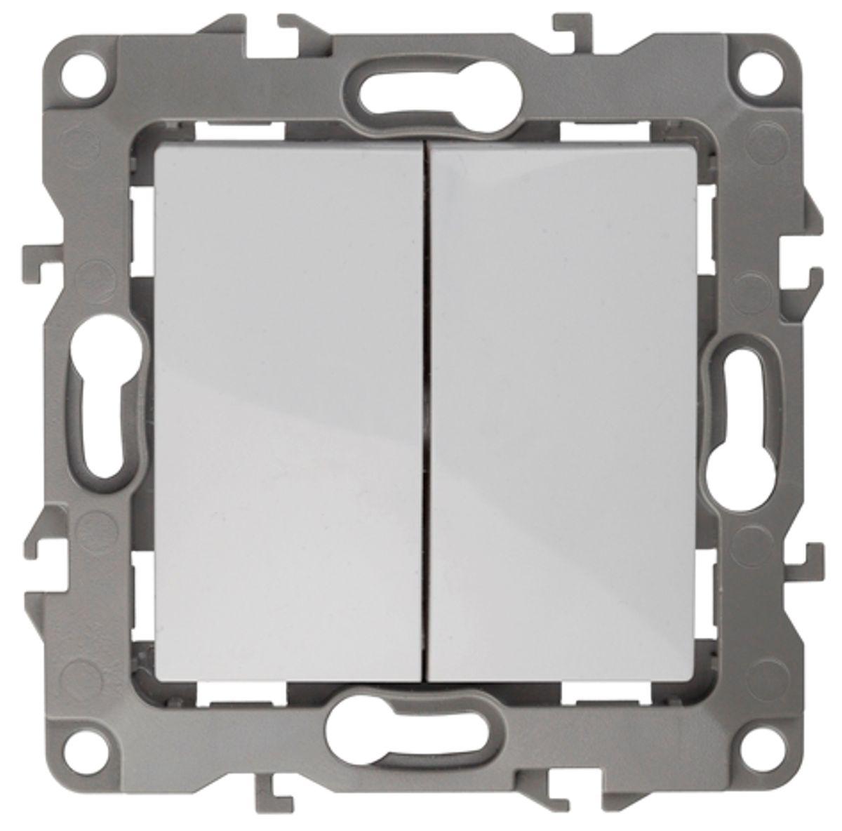 Выключатель ЭРА, двойной, цвет: белый, серый. 12-100412-1004-01Двойной выключатель ЭРА выполнен из прочного пластика, контакты бронзовые. Изделие просто в установке, надежно в эксплуатации. Выключатель имеет специальные фиксаторы, которые не дают ему смещаться как при монтаже, так и в процессе эксплуатации. Автоматические зажимы кабеля обеспечивают быстрый и надежный монтаж изделия к электросети без отвертки и не требуют обслуживания в отличие от винтовых зажимов. УВАЖАЕМЫЕ КЛИЕНТЫ! Обращаем ваше внимание на тот факт, что монтажные лапки в комплект не входят.