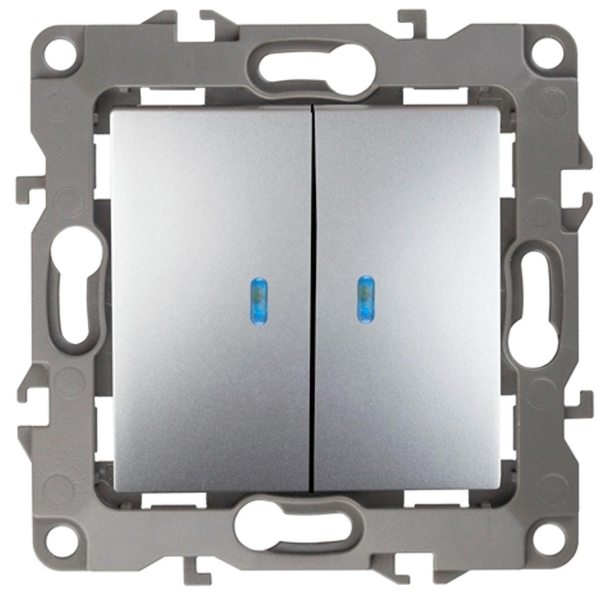Выключатель ЭРА, двойной, с подсветкой, цвет: серый. 12-110512-1105-03Двойной выключатель ЭРА выполнен из прочного пластика, контакты бронзовые. Световой индикатор на клавишах поможет вам разглядеть выключатель даже в темноте. Изделие просто в установке, надежно в эксплуатации. Выключатель имеет специальные фиксаторы, которые не дают ему смещаться как при монтаже, так и в процессе эксплуатации. Автоматические зажимы кабеля обеспечивают быстрый и надежный монтаж изделия к электросети без отвертки и не требуют обслуживания в отличие от винтовых зажимов.