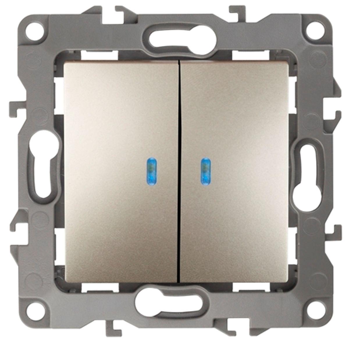 Выключатель ЭРА, двойной, с подсветкой, цвет: шампань, серый. 12-1105-0412-1105-04Двойной выключатель ЭРА выполнен из прочного поликарбоната, контакты - бронзовые. Световой индикатор на клавишах поможет вам разглядеть выключатель даже в темноте. Выключатель имеет специальные фиксаторы, которые не дают ему смещаться как при монтаже, так и в процессе эксплуатации. Автоматические зажимы кабеля обеспечивают быстрый и надежный монтаж изделия к электросети без отвертки и не требуют обслуживания в отличие от винтовых зажимов.