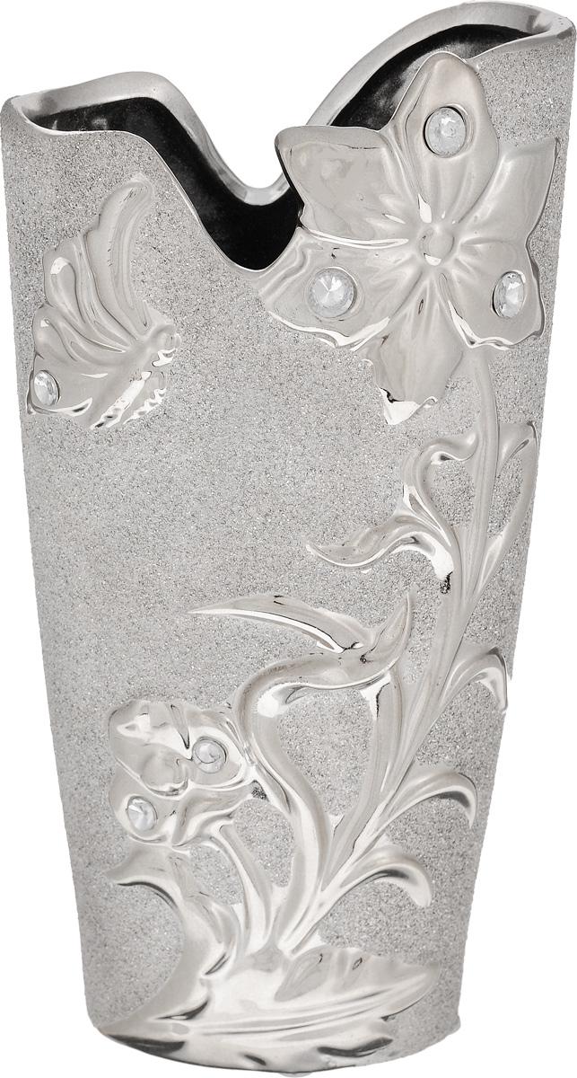 Ваза Sima-land Летнее настроение, высота 25,4 см865946Ваза Sima-land Летнее настроение, изготовленная из высококачественной керамики, оформлена объемными изображениями и декорирована стразами и блестками. Дно изделия оснащено нескользящими накладками. Интересная форма и необычное оформление сделают эту вазу замечательным украшением интерьера. Она предназначена как для живых, так и для искусственных цветов. Любое помещение выглядит незавершенным без правильно расположенных предметов интерьера. Они помогают создать уют, расставить акценты, подчеркнуть достоинства или скрыть недостатки.
