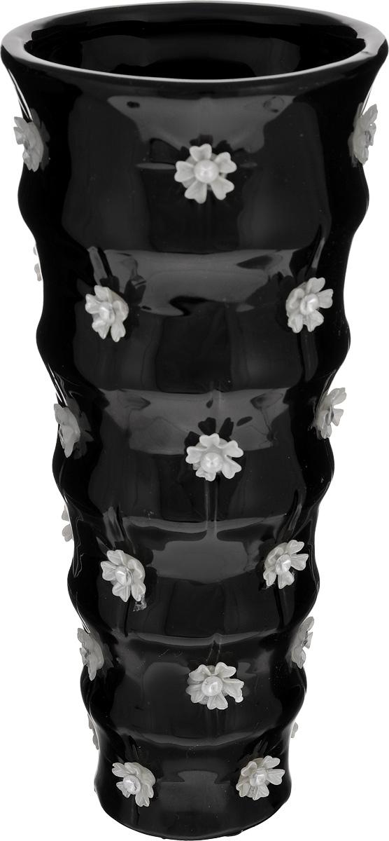 Ваза Sima-land Цветочный дождь, высота 22,5 см866196Ваза Sima-land Цветочный дождь, изготовленная из высококачественной керамики, декорирована объемными пластиковыми элементами в виде цветков со стразами. Дно изделия оснащено противоскользящими накладками. Вазу можно использовать как декоративный элемент, поставить в нее букет прекрасных цветов или декоративных веточек. Нарядная ваза Sima-land Цветочный дождь станет великолепным подарком на любой праздник. Диаметр вазы (по верхнему краю): 10,3 см. Высота вазы: 22,5 см.