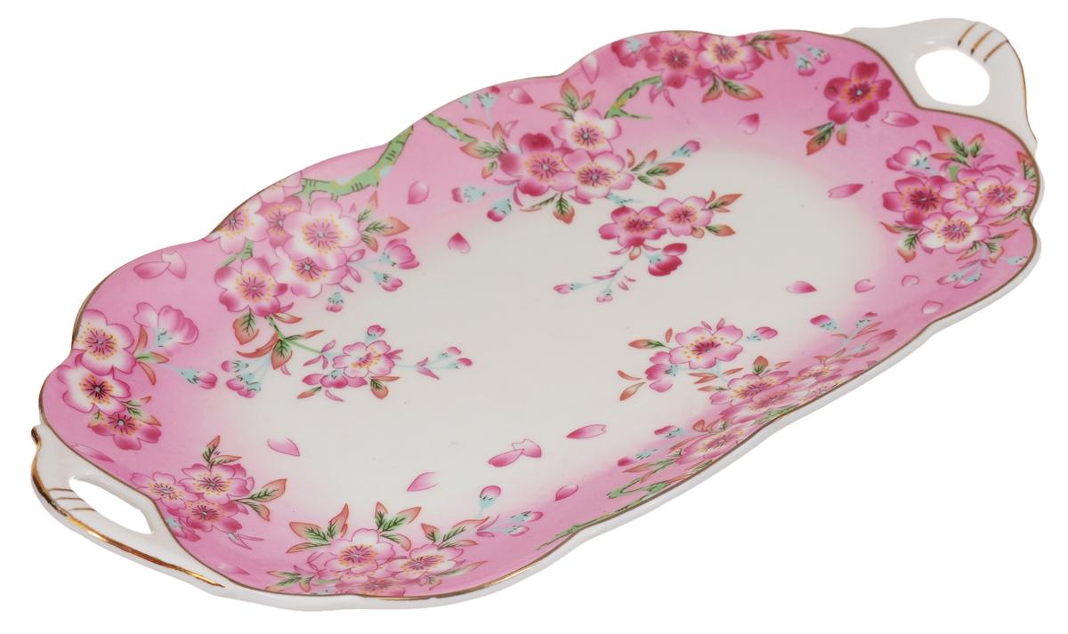 Блюдо для нарезки Elan Gallery Сакура, 30 х 15 см740160Блюдо для нарезки Elan Gallery Сакура, изготовленное из керамики, прекрасно подойдет для подачи нарезок, закусок и других блюд. Блюдо дополнено двумя удобными ручками и оформлено цветочным рисунком. Такое блюдо украсит сервировку вашего стола и подчеркнет прекрасный вкус хозяйки. Не рекомендуется применять абразивные моющие средства. Не использовать в микроволновой печи. Размер блюда по верхнему краю (с учетом ручек): 30 х 15 см.