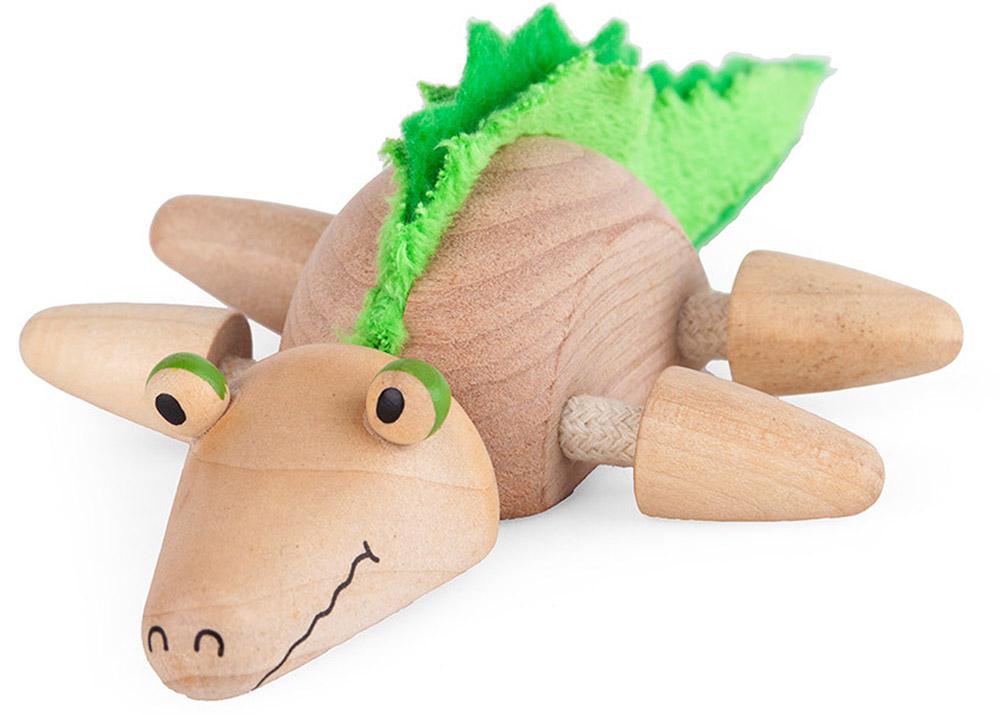Anamalz Деревянная игрушка КрокиCR2010Деревянная игрушка Anamalz Кроки - это веселый маленький крокодильчик, который, несомненно, придется по душе вашему ребенку! Игрушка выполнена из дерева и окрашена вручную. Лапки и голова крокодильчика подвижны, а на спине у него - гребень из мягкого и приятного на ощупь текстиля. Игры с такой игрушкой способствуют эмоциональному и творческому развитию малыша. Придумывая и разыгрывая различные истории, ребенок сможет развить мелкую моторику, воображение, тактильное и цветовое восприятие. Придуманные австралийским дизайнером Луизой Косан-Скотт, игрушки AnaMalz завоевали более 15 отраслевых наград, включая Австралийскую международную награду в области дизайна, присуждаемую организацией Standards Australia. AnaMalz изготовлены из дерева, называемого schima superba или игольчатое дерево (быстрорастущее дерево, выращиваемое на лесных плантациях). Все игрушки AnaMalz раскрашиваются вручную с использованием безопасной для детей краски и...